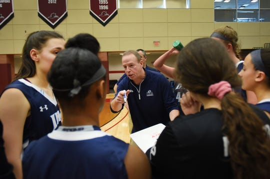 IHA Head Coach Steve Silver advises his team as they play against Saddle River Day in the second half during the Bergen County girls basketball final at Ramapo College in Mahwah on 02/17/19.