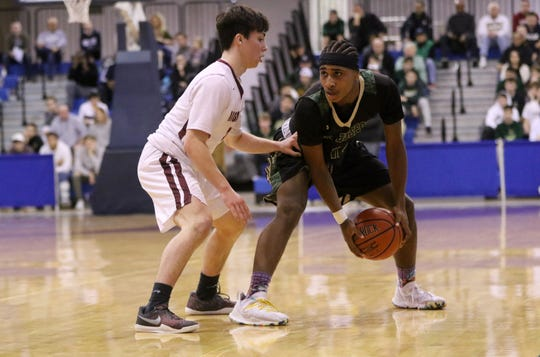Daniel Lans, of St. Joseph's, looks for an opening past Pat O'Gorma, of Don Bosco Prep.  Prep beat St. Joe's, 51-45 in their Bergen County Jamboree semifinals game. Sunday, February 17, 2019