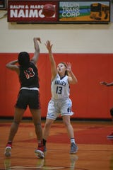 Kennedy's Taniesha Gilbert is on offense as Wayne Valley's Hailey Cabanas, facing, defends during a Passaic County semifinal at Kennedy on Saturday, Feb. 16, 2019 .