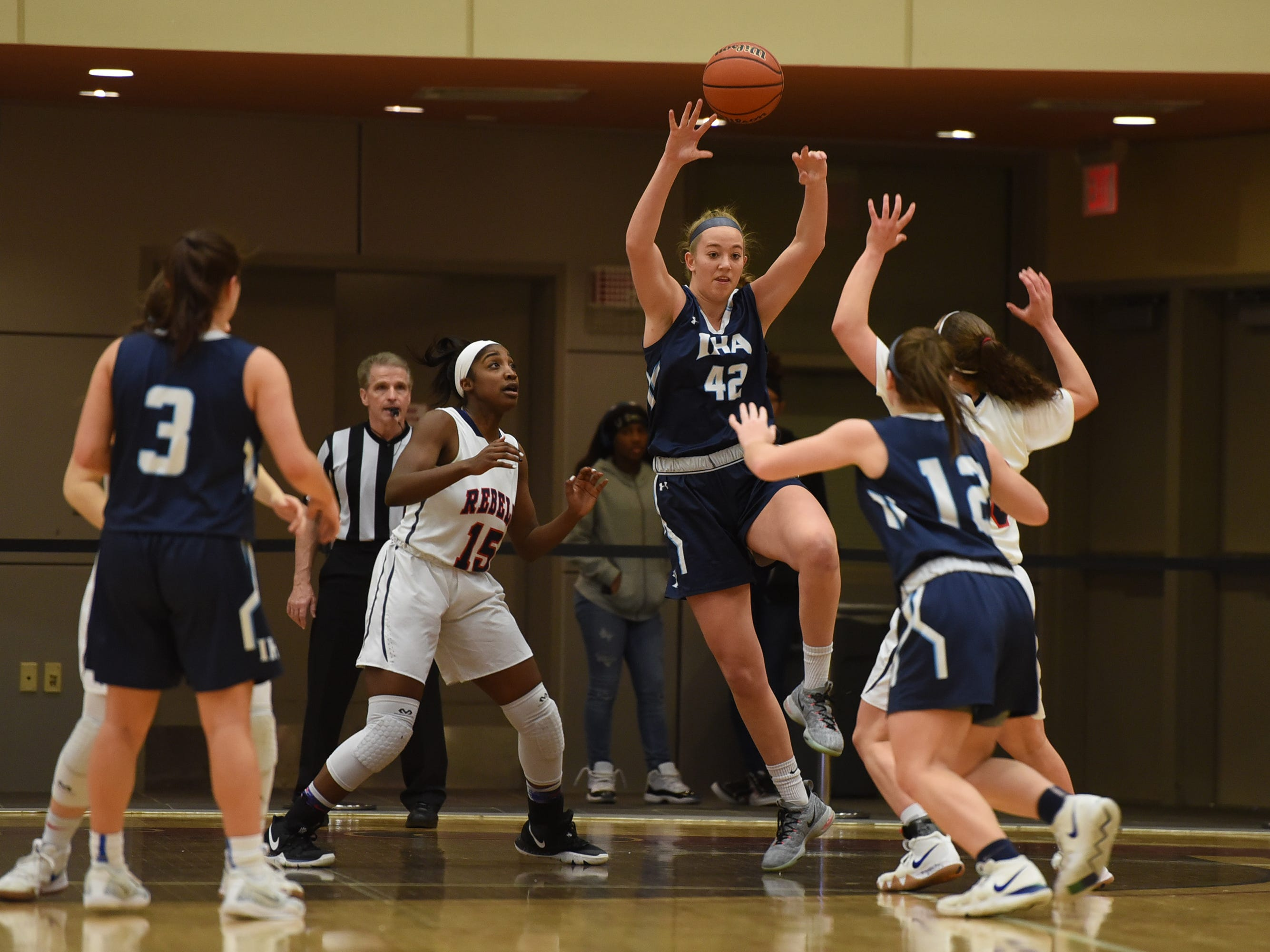 Anna Morris (no.42) of Immaculate Heart Academy makes a pass as they play against Saddle River Day in the first half during the Bergen County girls basketball final at Ramapo College in Mahwah on 02/17/19.