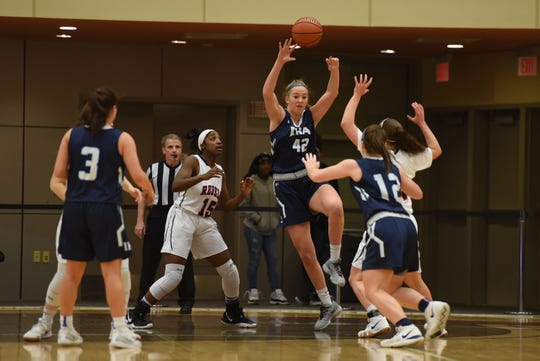 Anna Morris (no.42) of Immaculate Heart Academy makes a pass during a February game.