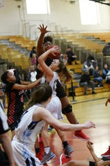 Kennedy forward Jimmirah Johnson (23) goes up to block a shot while Kiana Hardison (4) helps on defense in the Knights' Passaic County quarterfinal game against Wayne Valley.