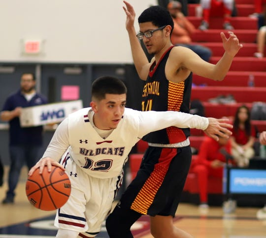 Senior Daniel Garcia (12) worked his way free on the baseline and looks for the kick-out during Friday's 66-42 loss to the Centennial Hawks. Garcia led the 'Cats with 14 points.