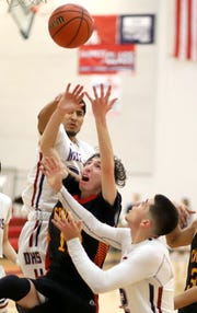 Jose Trevizo (top) and Daniel Garcia (bottom) worked hard off the glass during Friday's 24-point loss to the visiting Centennial Hawks.