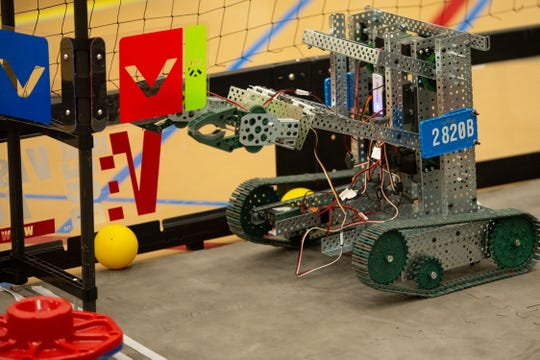 Robot 2820B, from the Hawk Nation team at Centennial High School, performs a goal during the VEX Robotics competition for elementary, middle and high school students, held on the NMSU campus on February 16, 2019.
