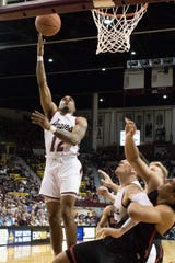 New Mexico State guard AJ Harris goes up for a lay up on Saturday against Seattle at the Pan American Center.