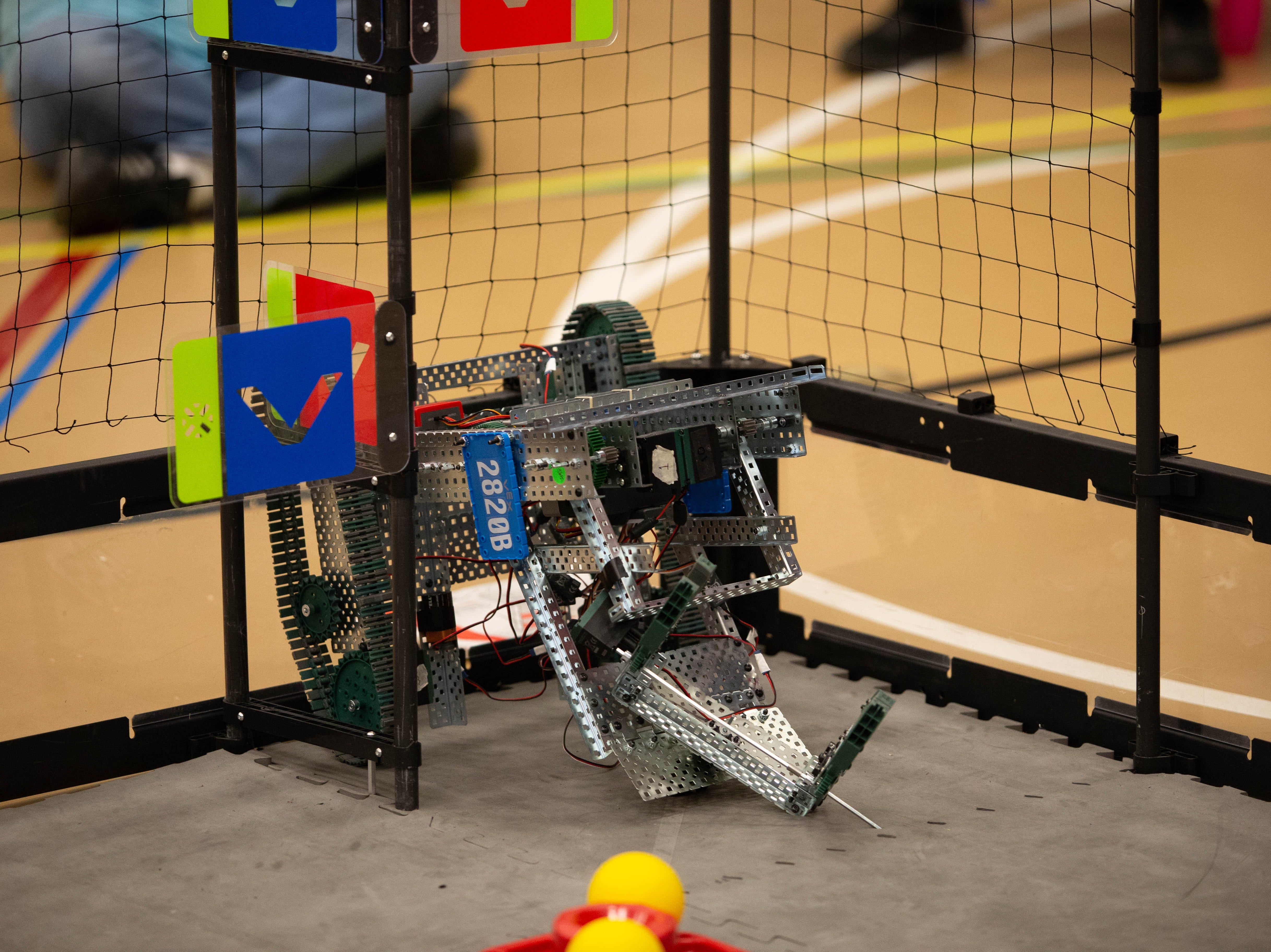 The Hawk Nation robot gets stuck on a barrier during the autonomous part of the VEX Robotics competition for elementary, middle and high school students, held on the NMSU campus on February 16, 2019.