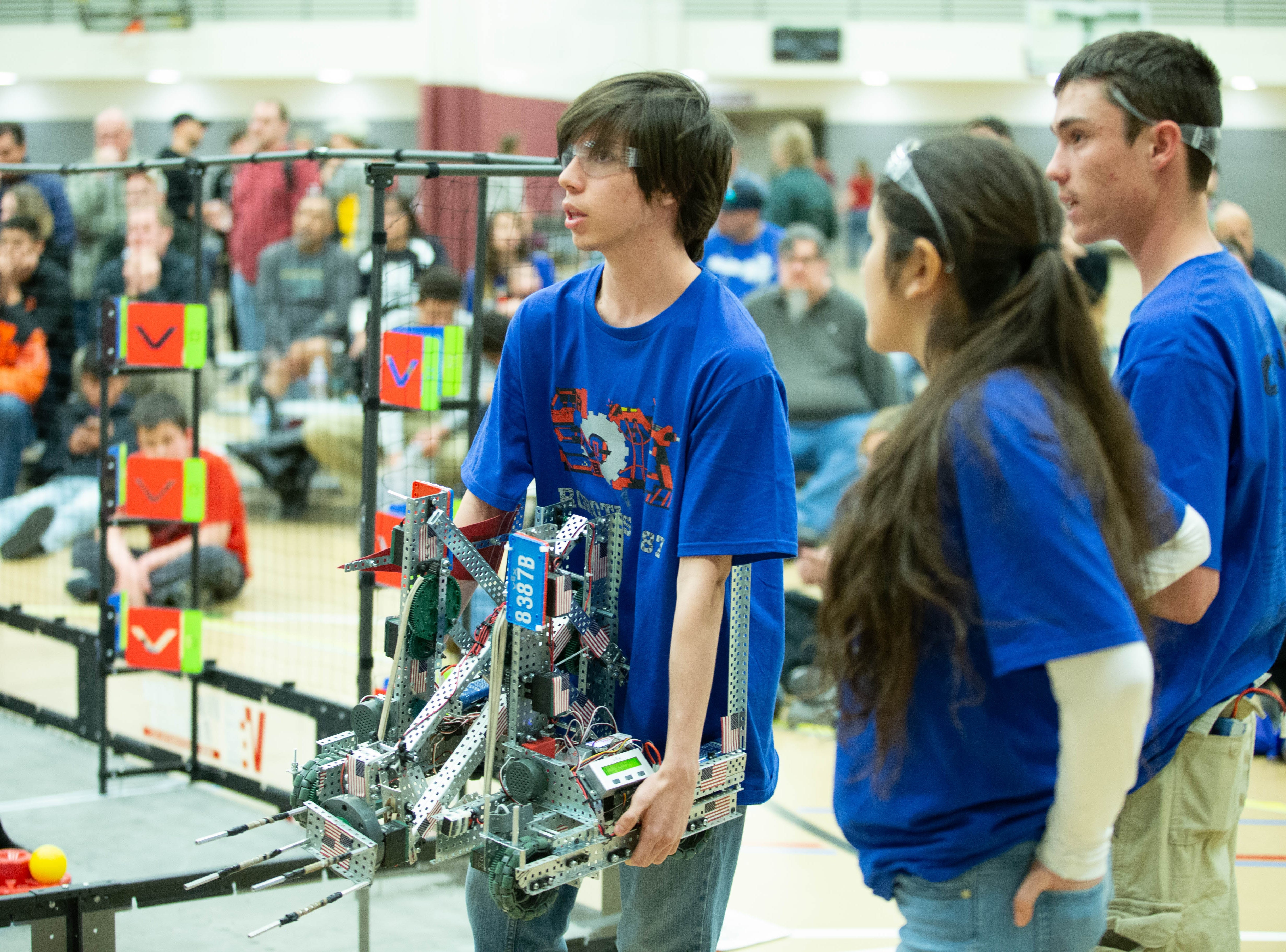 """Sesbastian Saenz, 18, with the School of Dreams Academy, holds a robot named """"Corbin's Girlfriend."""" The VEX Robotics competition for elementary, middle and high school students held on the NMSU campus on February 16, 2019."""