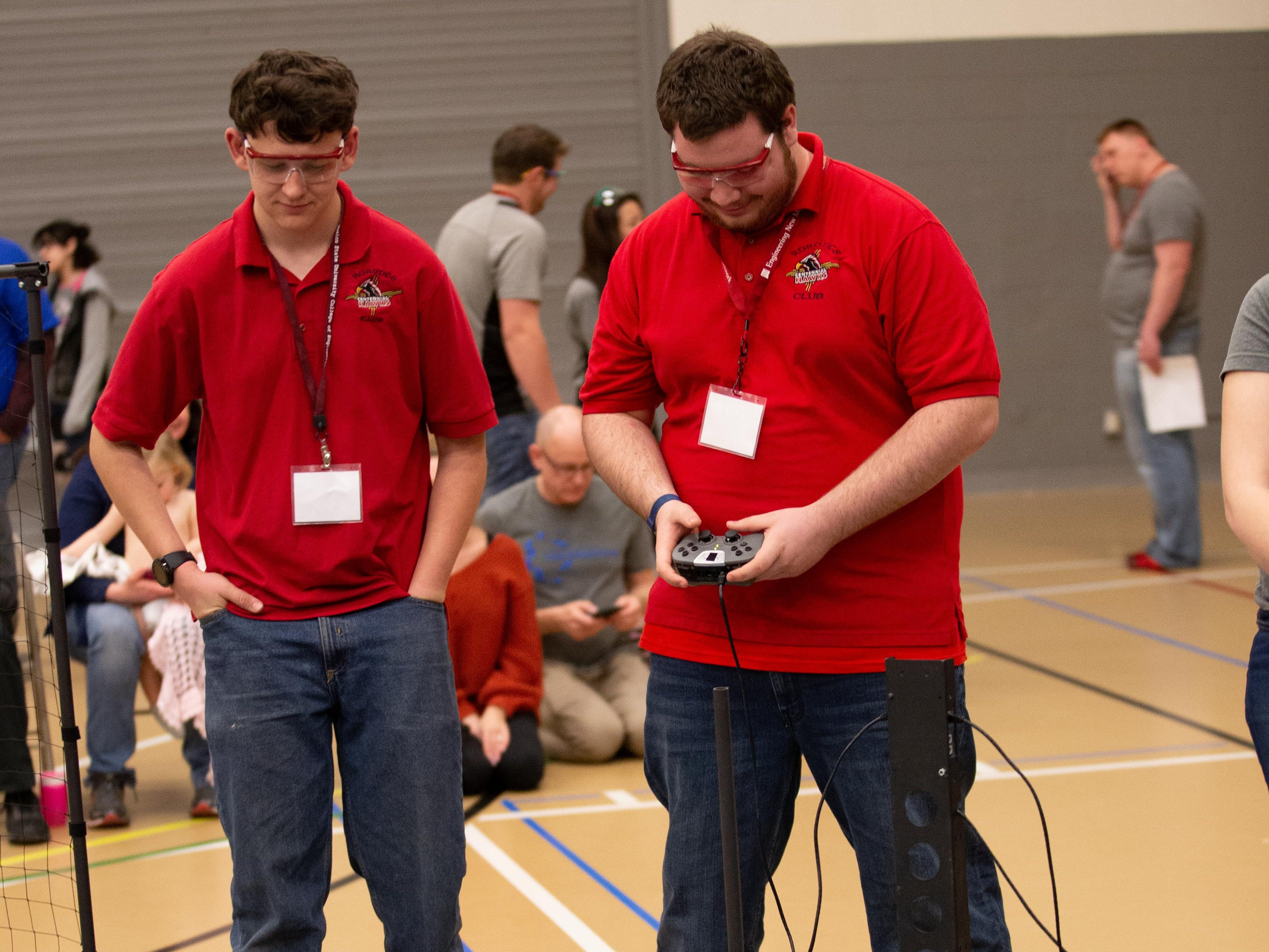William Monger, 16, and Joseph Leach, 18, of Centennial High School's Hawk Nation Team, control their robot during the VEX Robotics competition for elementary, middle and high school students, held on the NMSU campus on February 16, 2019.