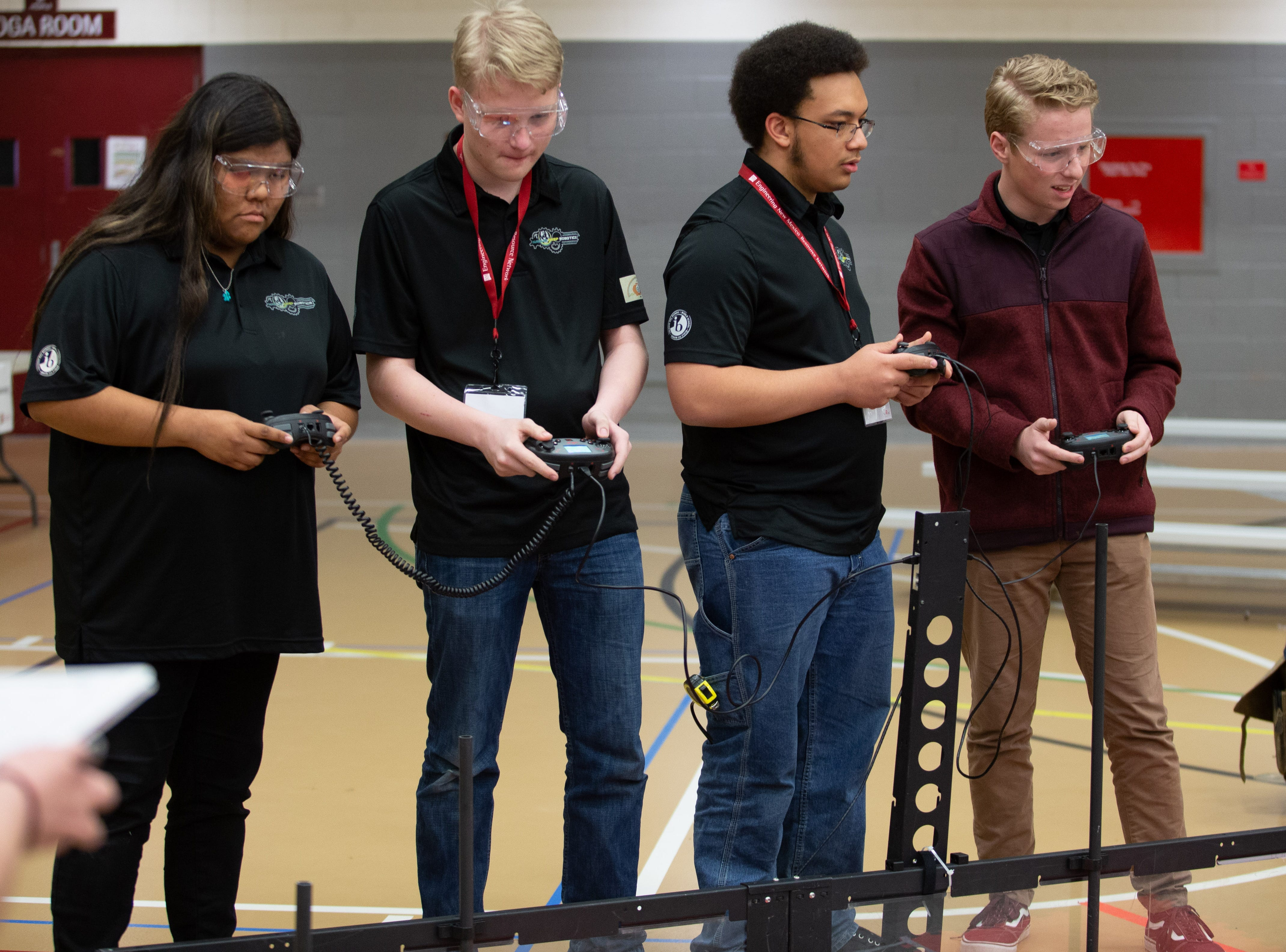 The team from Navajo Preporatory School ub Farmington consists of (from left) Taylor Yazzie, 18,  Xander Owen Jones, 18, Nathan Henry, 15, and Parker Jones, 17.  The VEX Robotics competition for elementary, middle and high school students held on the NMSU campus on February 16, 2019.