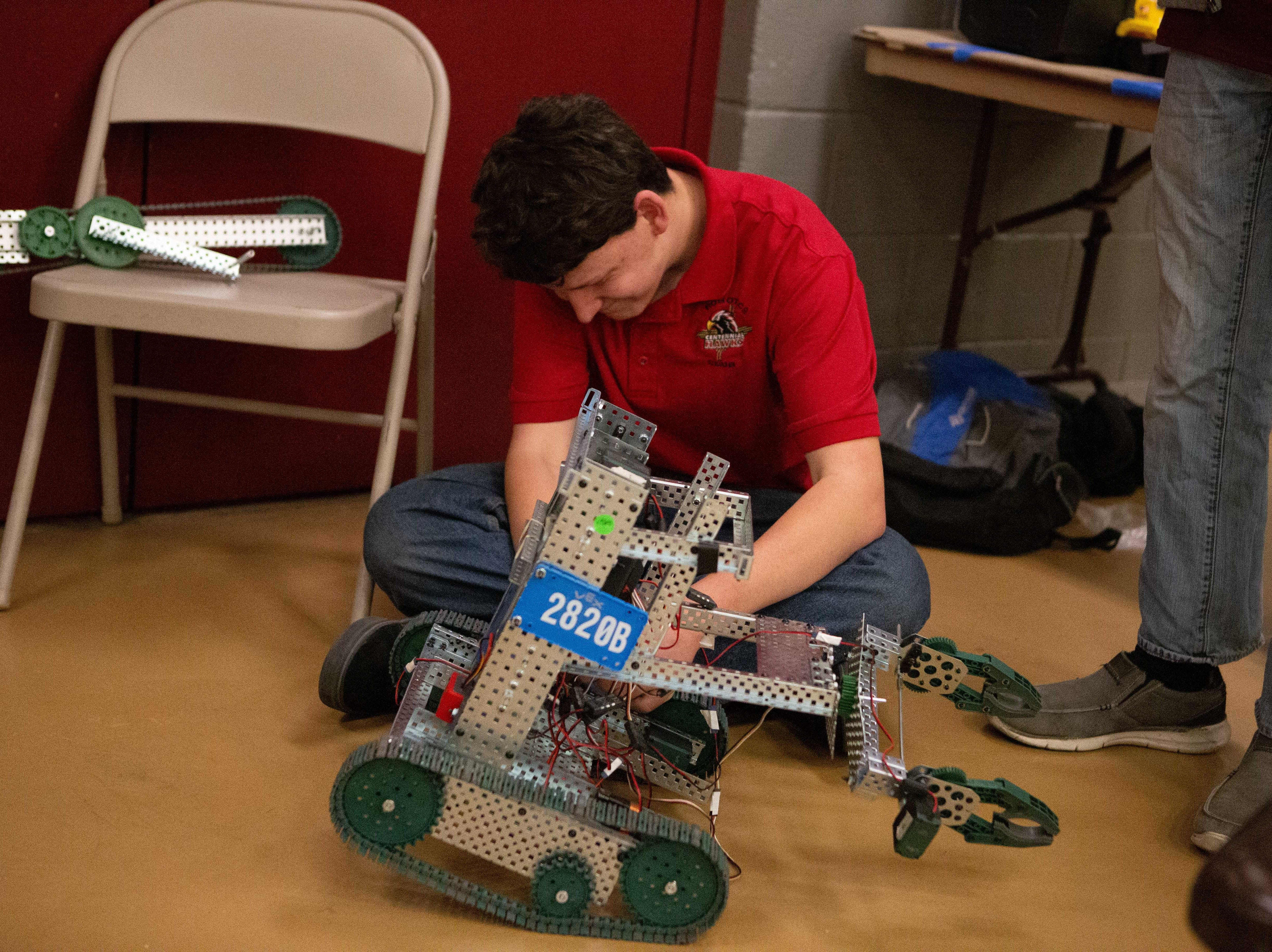 William Monger makes adjustments to the Hawk Nation robot during the VEX Robotics competition for elementary, middle and high school students, held on the NMSU campus on February 16, 2019.