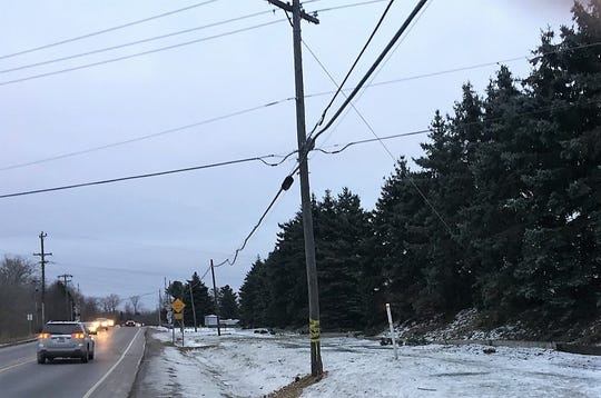 This power pole near the intersection of Warren and Lotz roads in Canton was damaged in a single-vehicle accident Saturday.