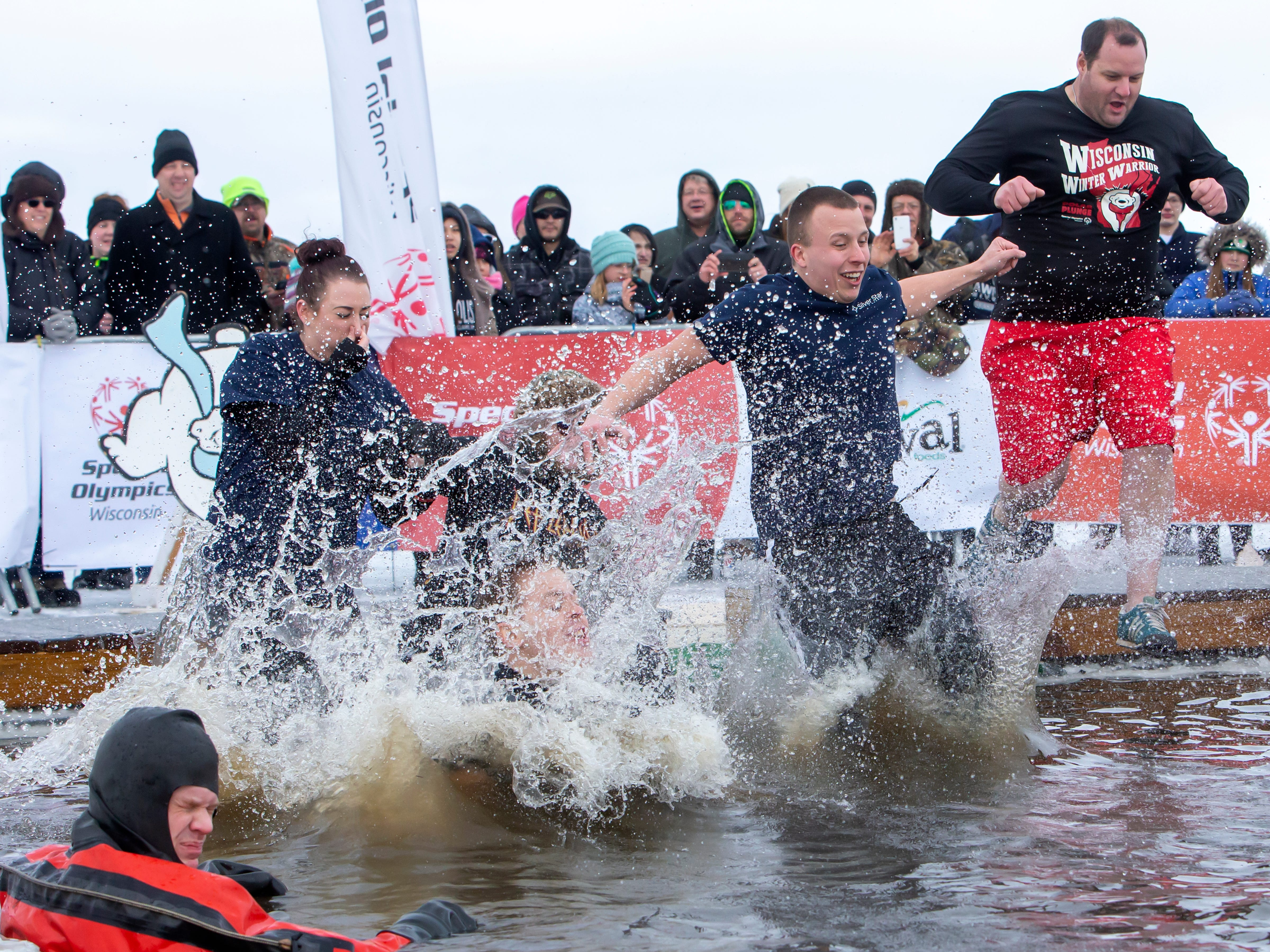 Groups of brave people participant in the Special Olympics Wisconsin Polar Plunge in Oshkosh, Wis., on Saturday, February 16, 2019, at Miller's Bay in Menominee Park.