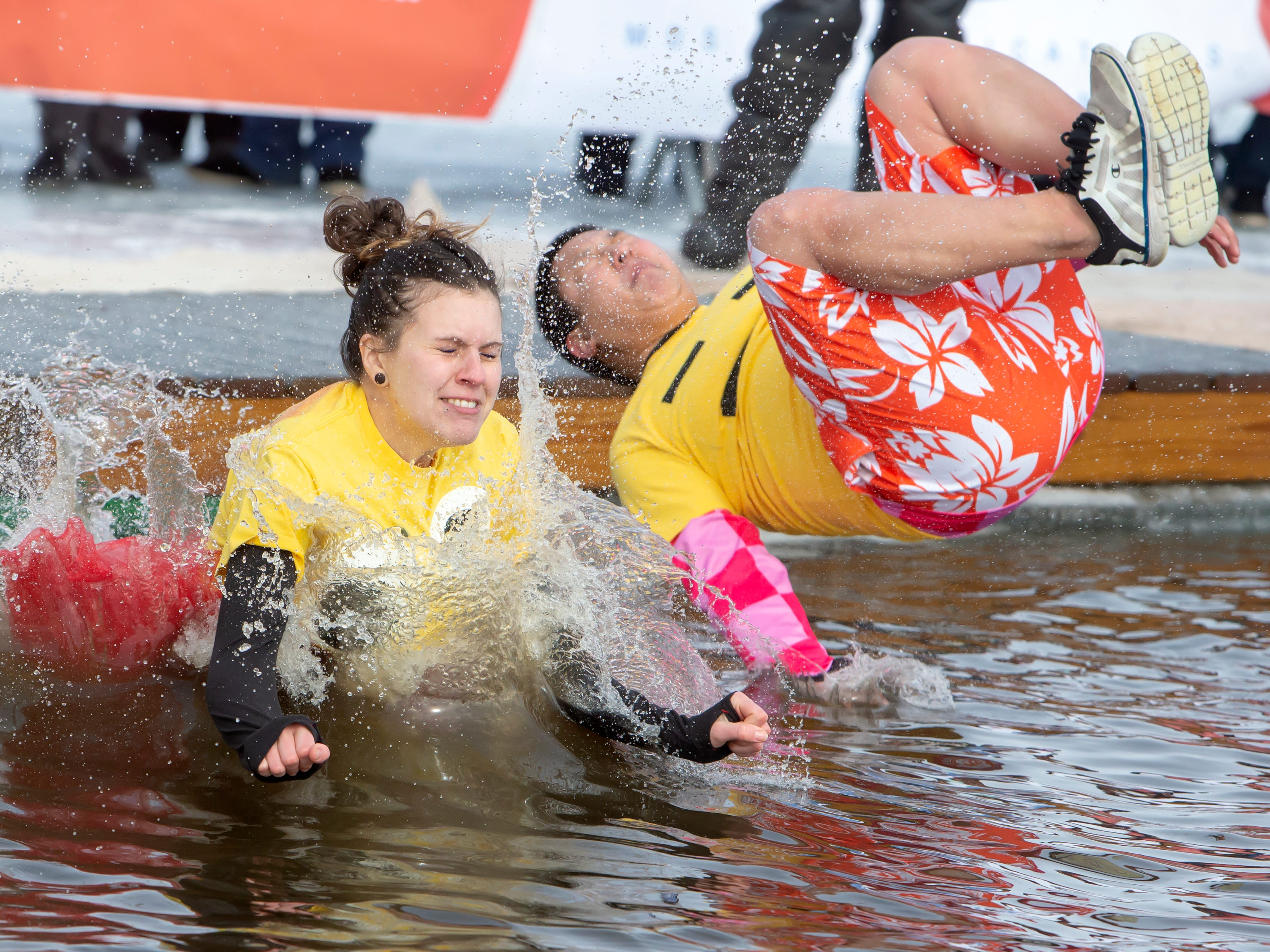 People brave the freezing water to fund raise during the Special Olympics Wisconsin Polar Plunge in Oshkosh, Wis, on Saturday, February 16, 2019, at Miller's Bay in Menominee Park.