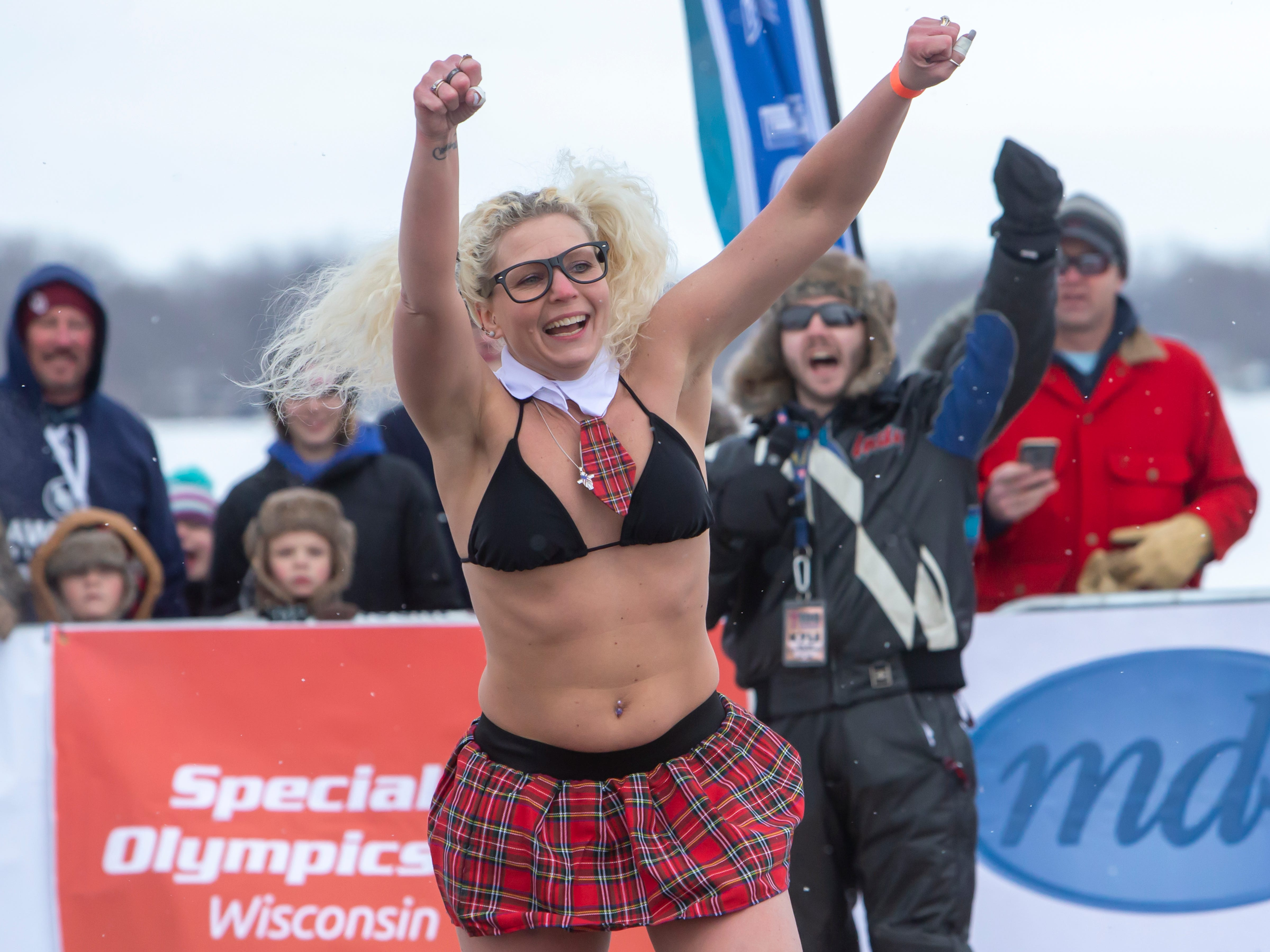 Jari Hall is a super plunger taking the first jump during the Special Olympics Wisconsin Polar Plunge in Oshkosh, Wis., on Saturday, February 16, 2019, at Miller's Bay in Menominee Park.