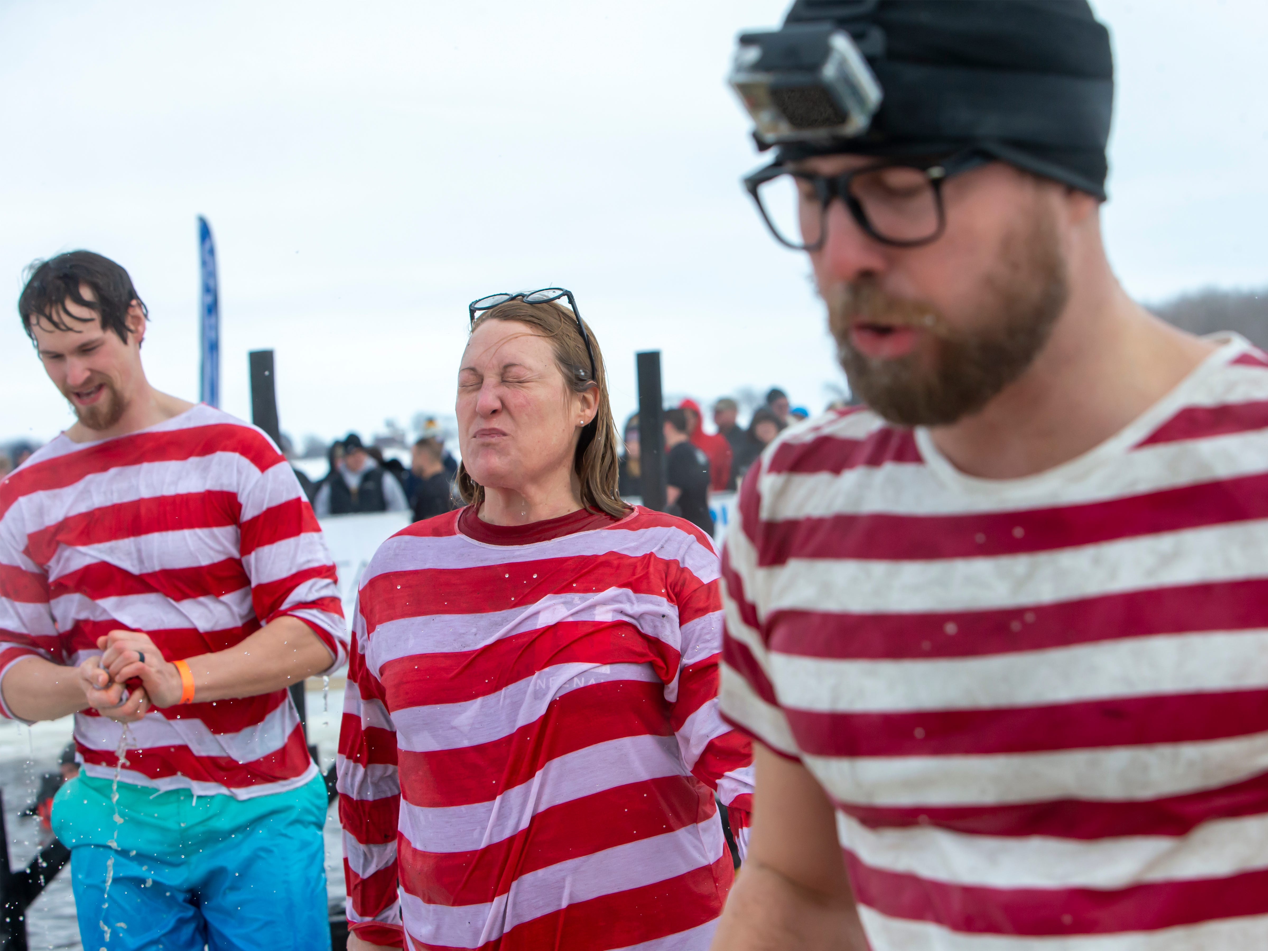 Neenah Inc. employee reacts after taking the plunge during the Special Olympics Wisconsin Polar Plunge in Oshkosh, Wis., on Saturday, February 16, 2019, at Miller's Bay in Menominee Park.