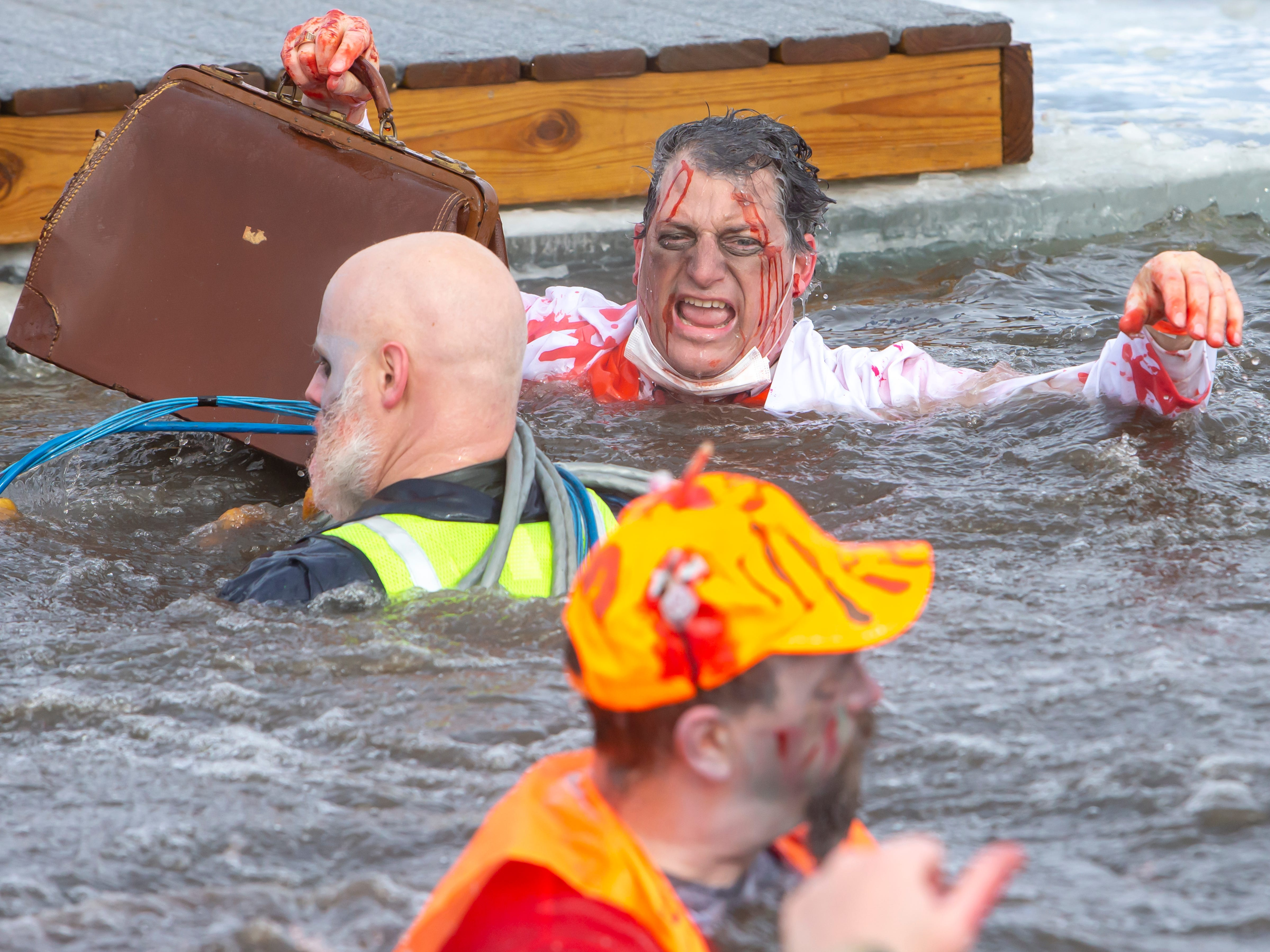 People come dressed in costume participating in the Special Olympics Wisconsin Polar Plunge in Oshkosh, Wis., on Saturday, February 16, 2019, at Miller's Bay in Menominee Park.