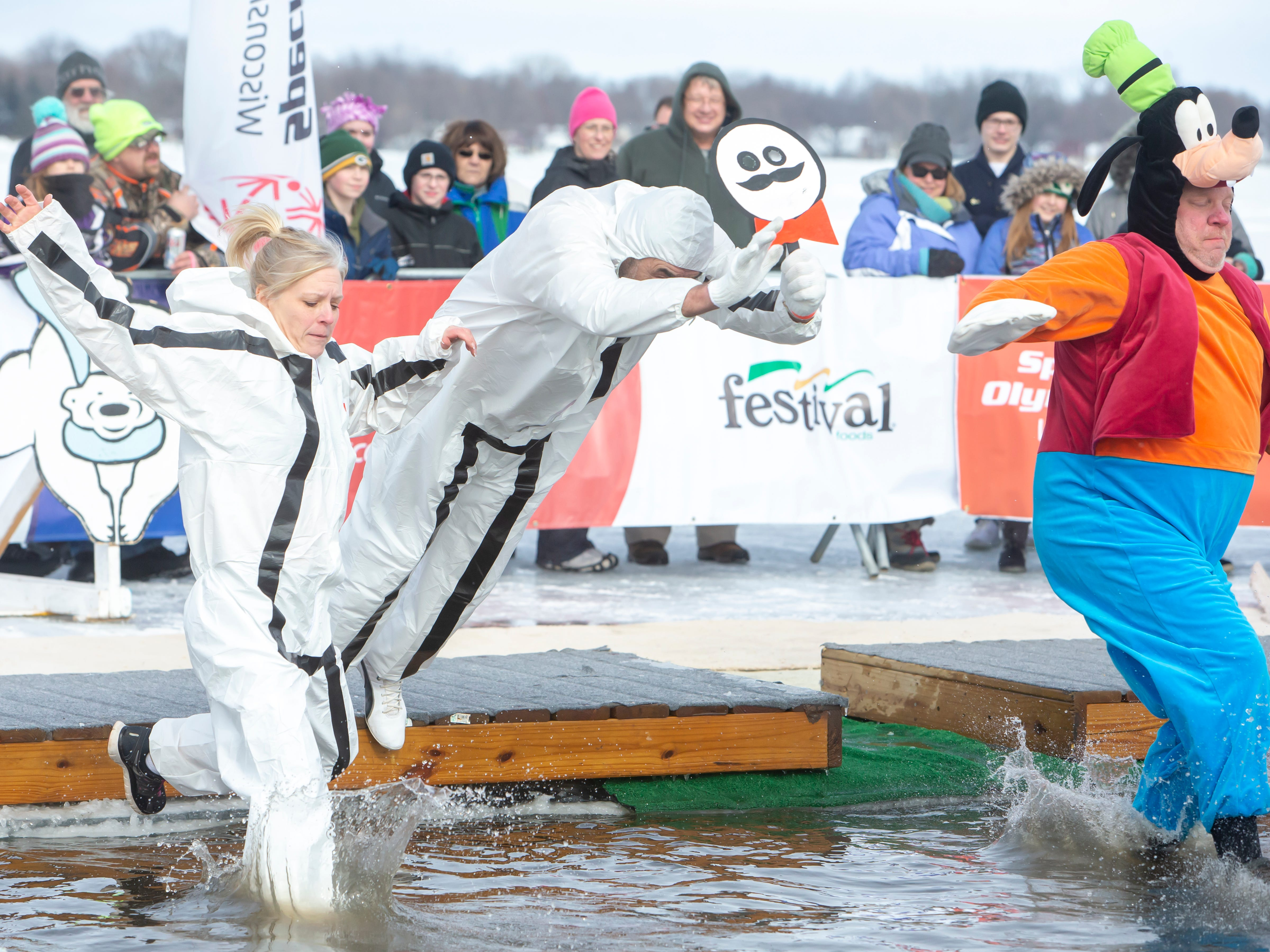 Groups dressed in costume take the plunge during the Special Olympics Wisconsin Polar Plunge in Oshkosh, Wis., on Saturday, February 16, 2019, at Miller's Bay in Menominee Park.