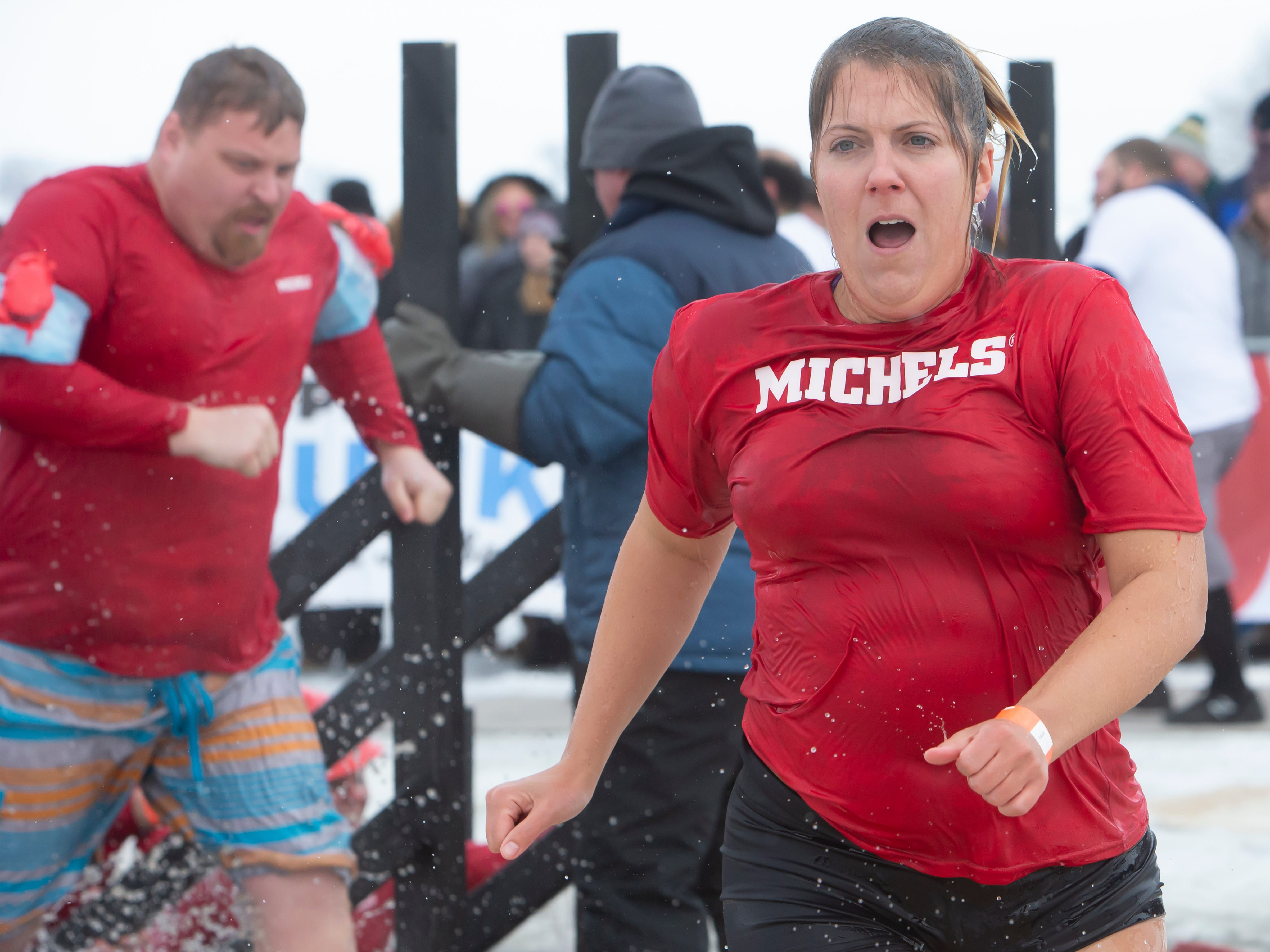 Michel's employee reacts after taking the plunge during the Special Olympics Wisconsin Polar Plunge in Oshkosh, Wis., on Saturday, February 16, 2019, at Miller's Bay in Menominee Park.
