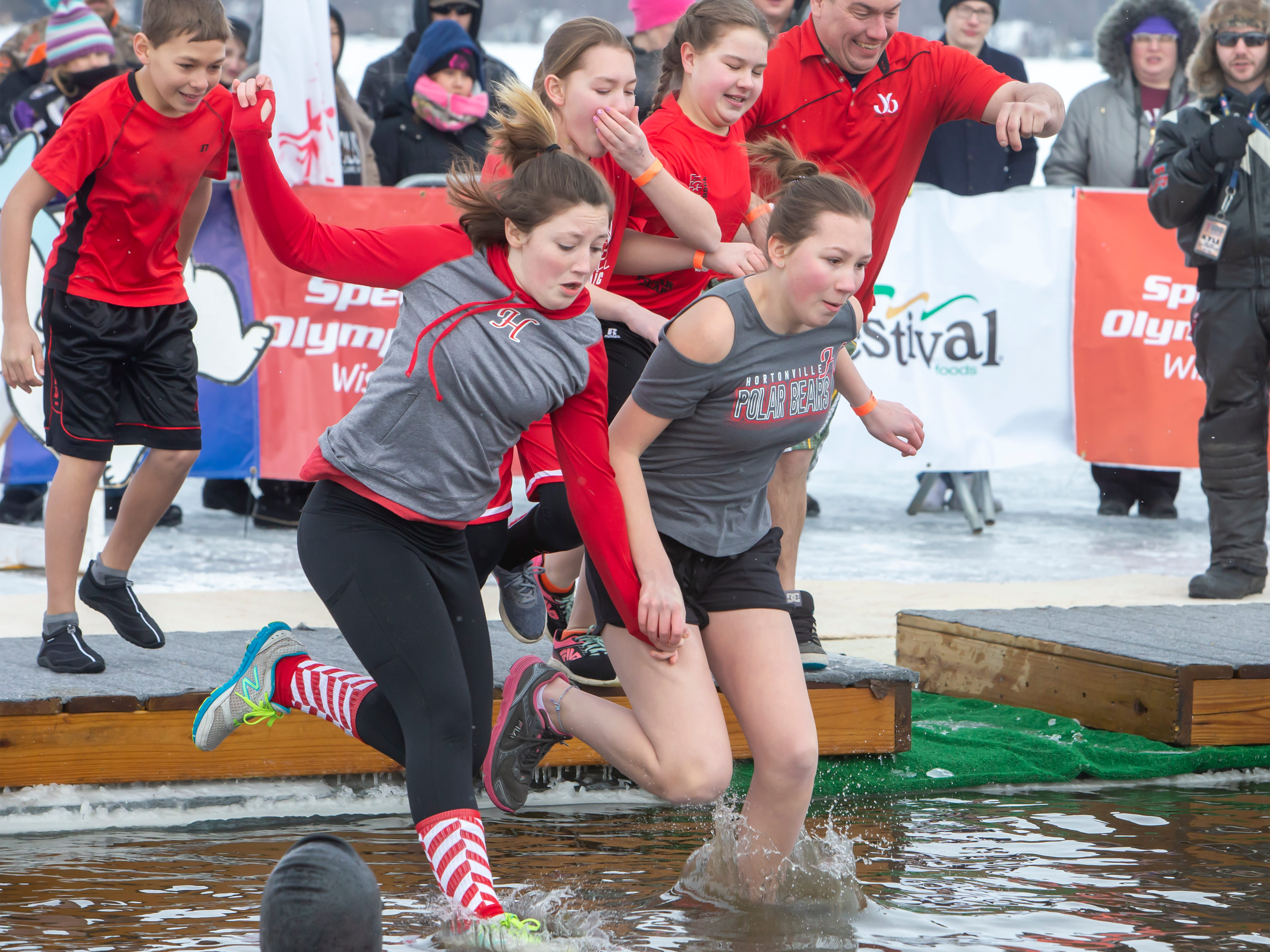 Hortonville High School students take the plunge during the Special Olympics Wisconsin Polar Plunge in Oshkosh, Wis., on Saturday, February 16, 2019, at Miller's Bay in Menominee Park.