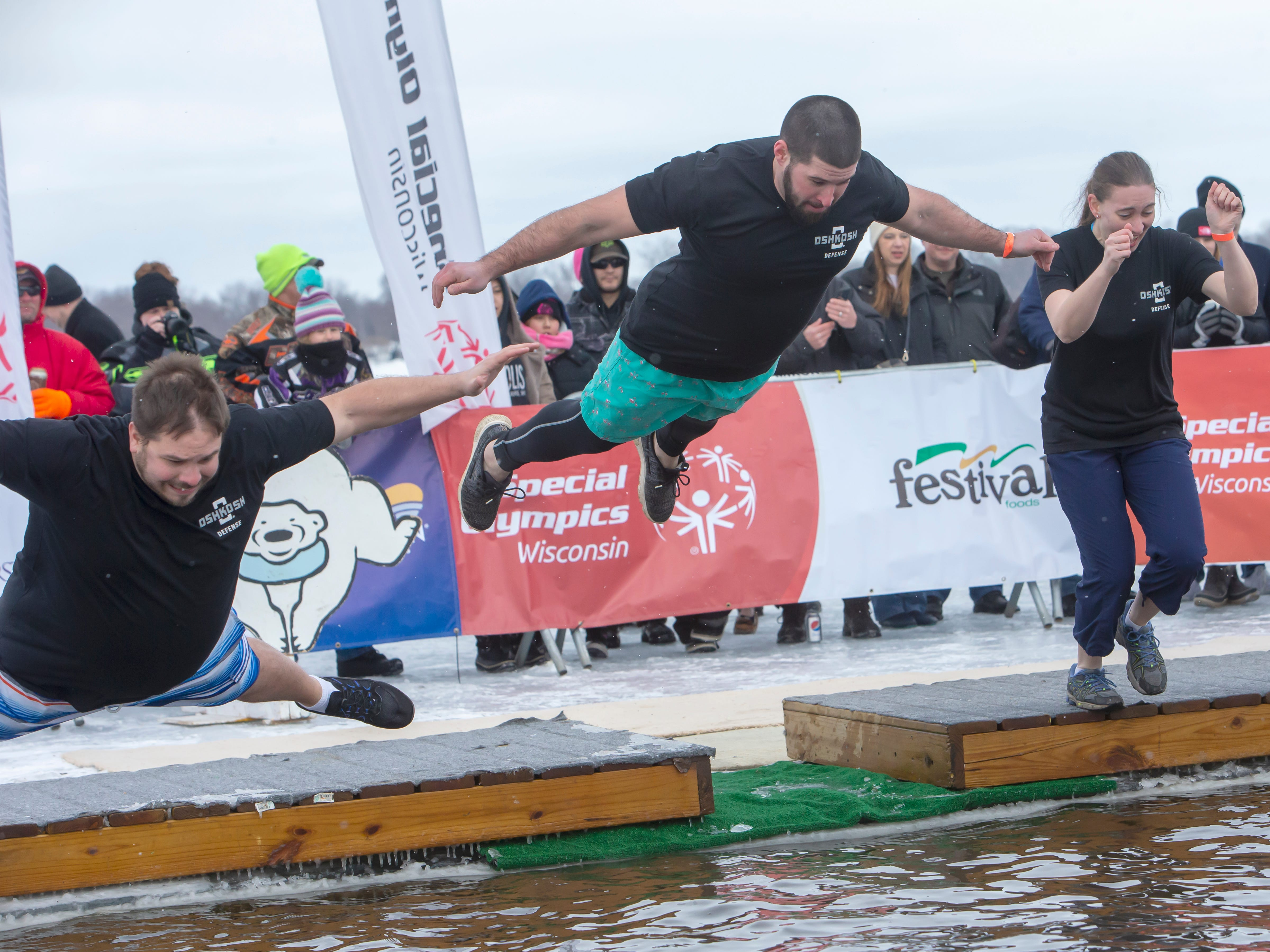 Oshkosh Defense employees brave the freezing water during the Special Olympics Wisconsin Polar Plunge in Oshkosh, Wis., on Saturday, February 16, 2019, at Miller's Bay in Menominee Park.