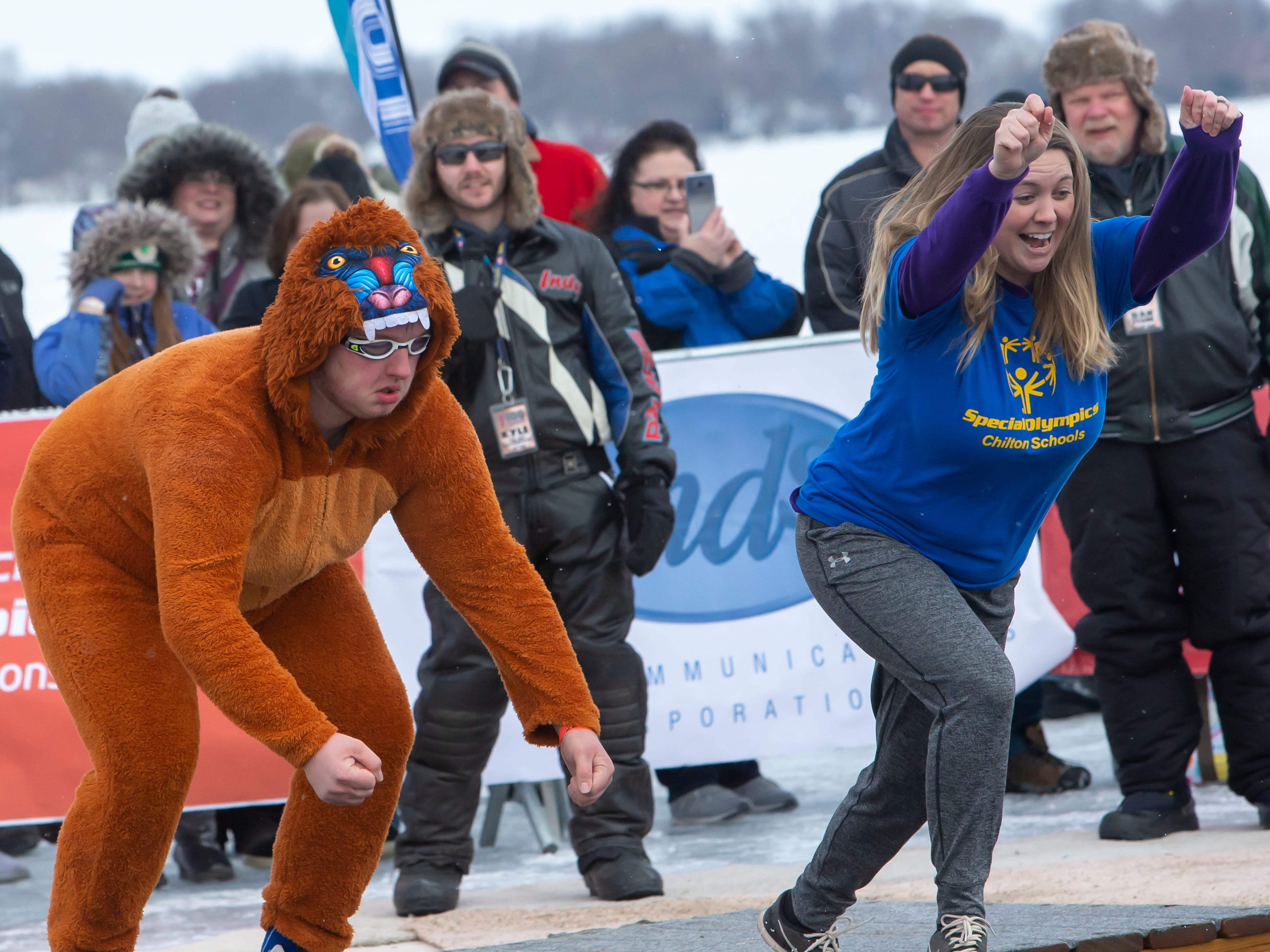 Participants count one, two, three, jump during the Special Olympics Wisconsin Polar Plunge in Oshkosh, Wis., on Saturday, February 16, 2019, at Miller's Bay in Menominee Park.