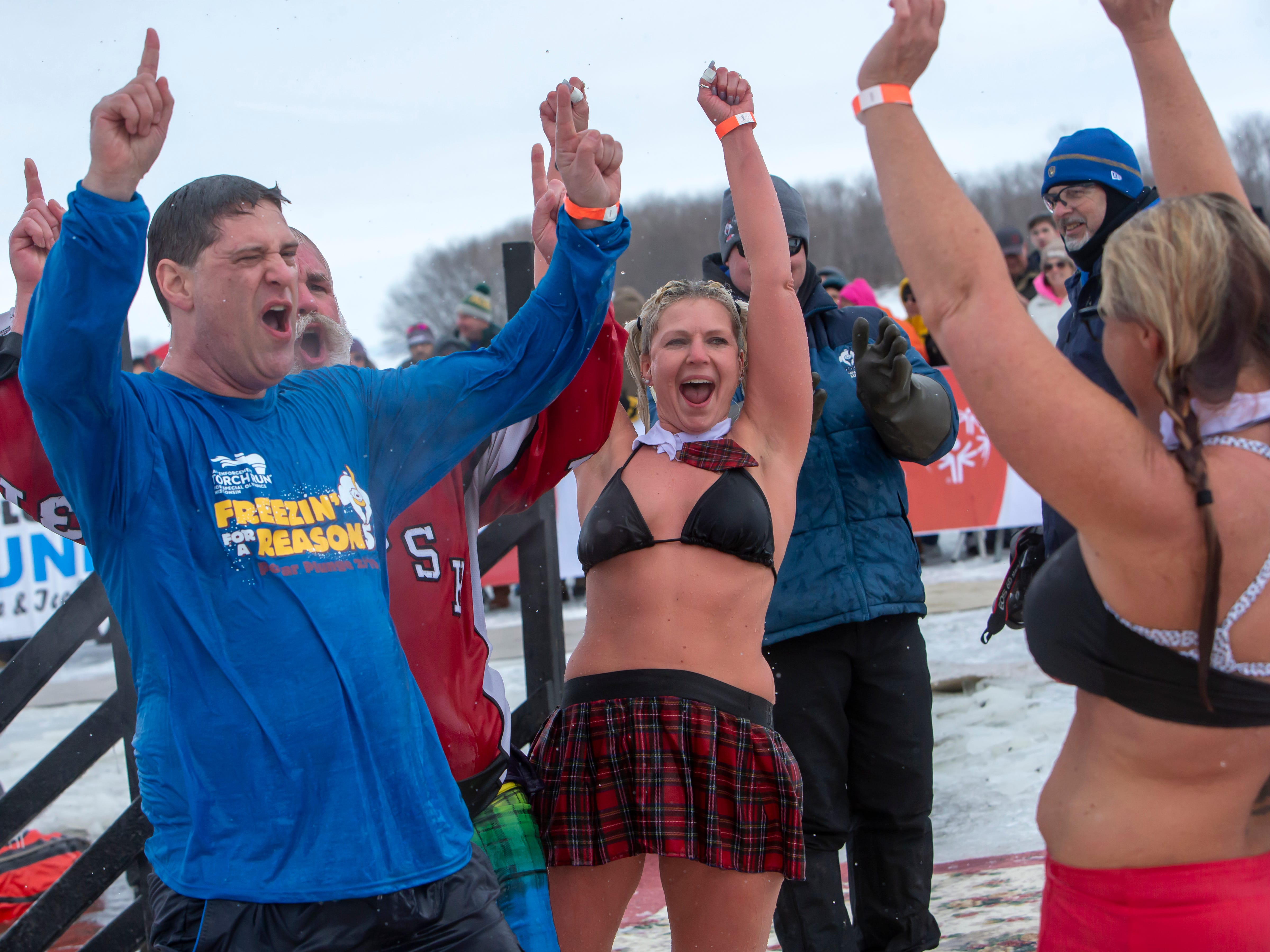 Super plungers start off the the Special Olympics Wisconsin Polar Plunge event in Oshkosh, Wis., on Saturday, February 16, 2019, at Miller's Bay in Menominee Park.
