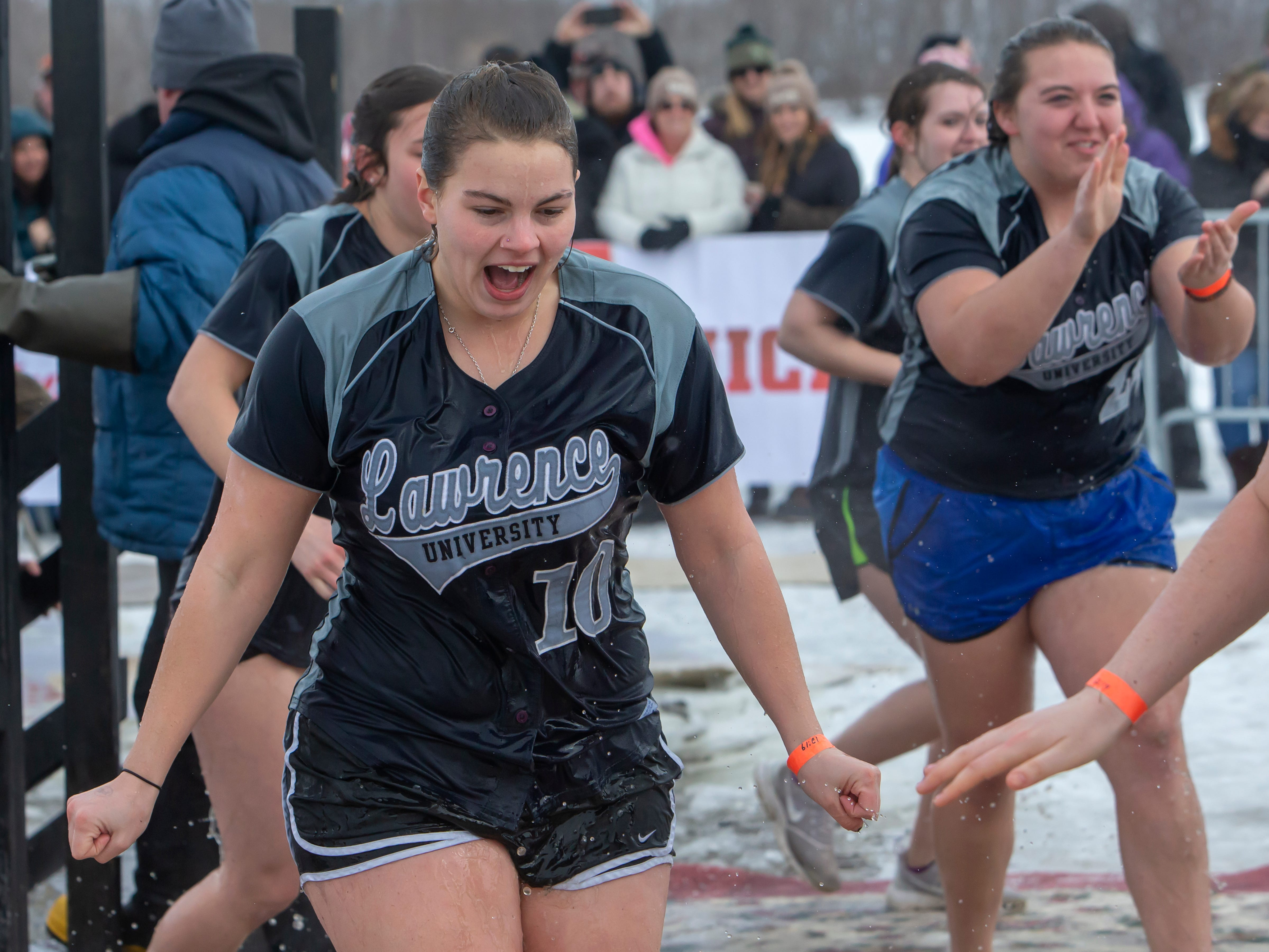 Lawrence University softball team takes the plunge during the Special Olympics Wisconsin Polar Plunge in Oshkosh, Wis., on Saturday, February 16, 2019, at Miller's Bay in Menominee Park.