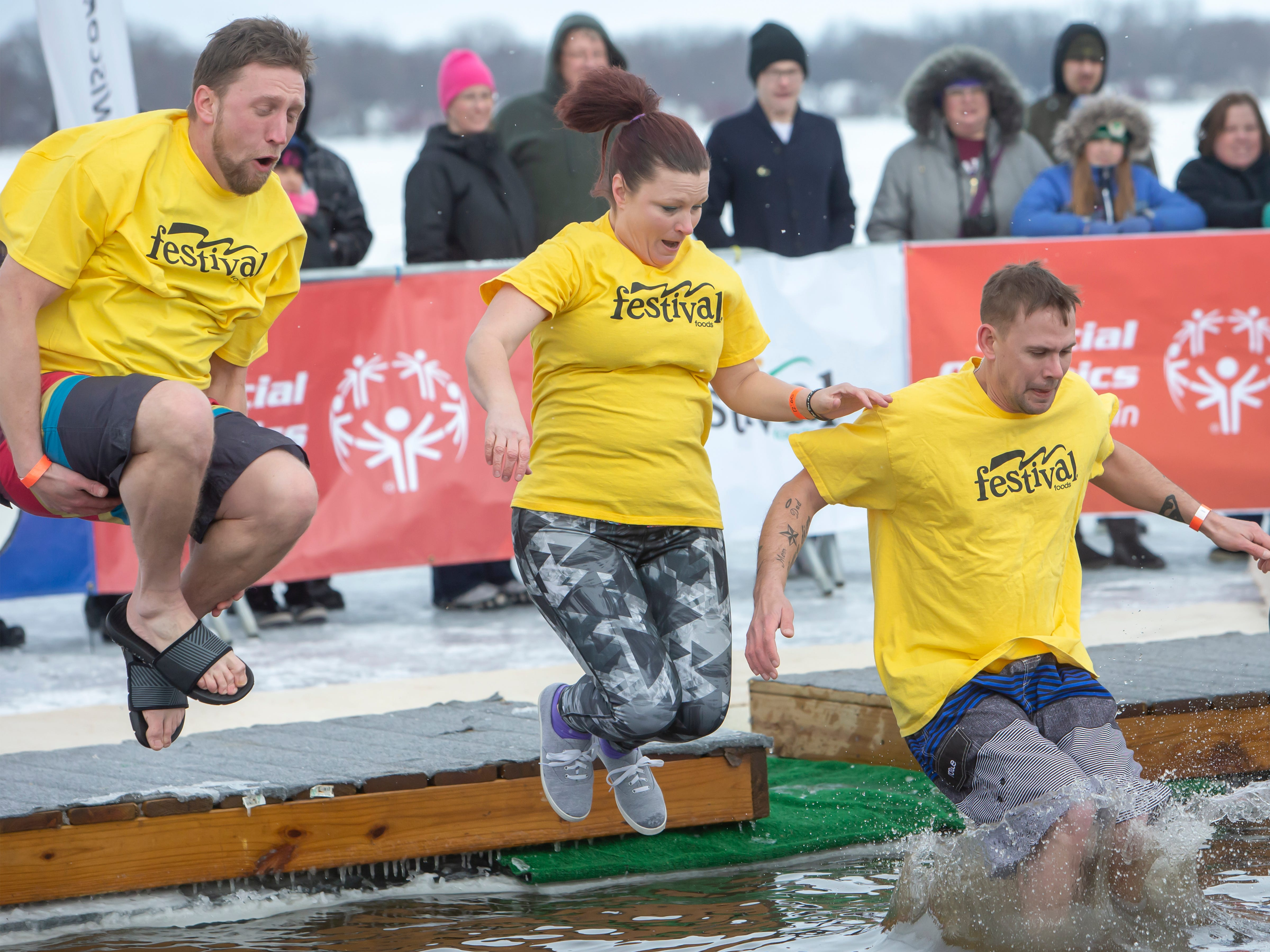 Festival Foods employees brave the cold plunging during the Special Olympics Wisconsin Polar Plunge in Oshkosh, Wis., on Saturday, February 16, 2019, at Miller's Bay in Menominee Park.