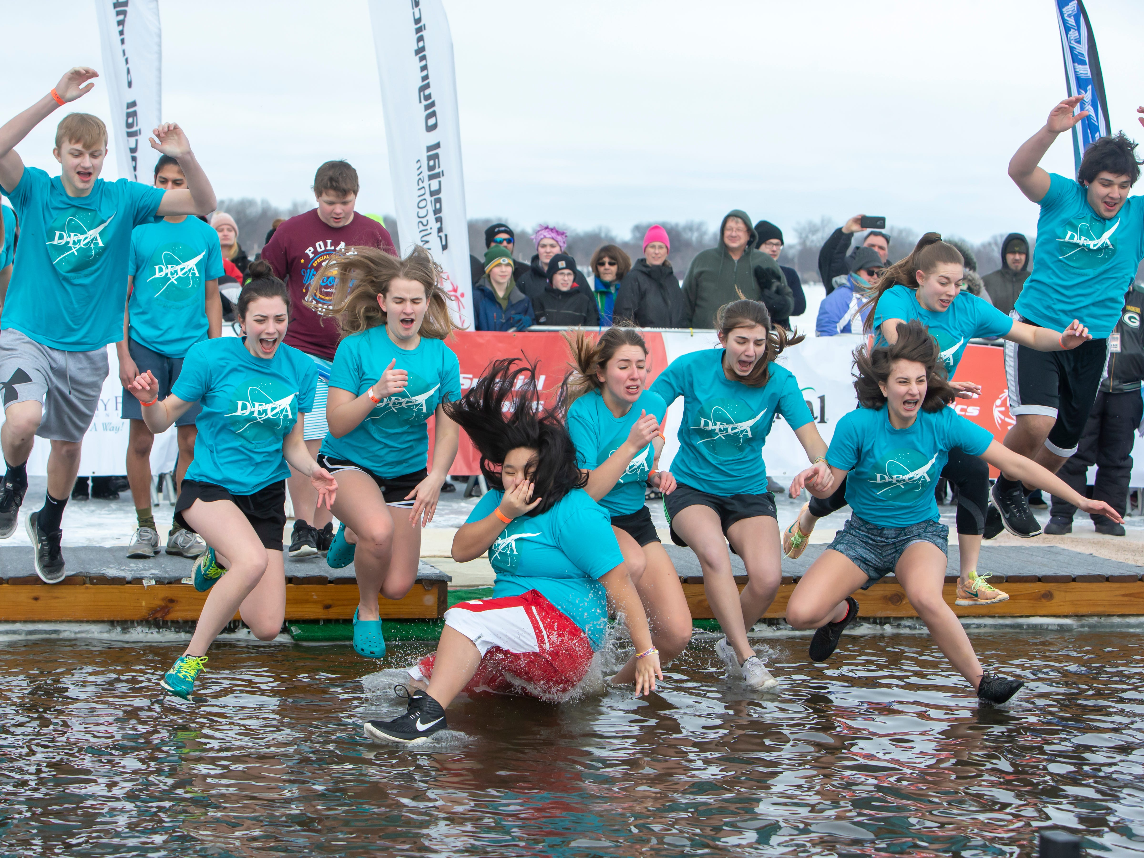 DECA students jump as a group during the Special Olympics Wisconsin Polar Plunge in Oshkosh, Wis., on Saturday, February 16, 2019, at Miller's Bay in Menominee Park.