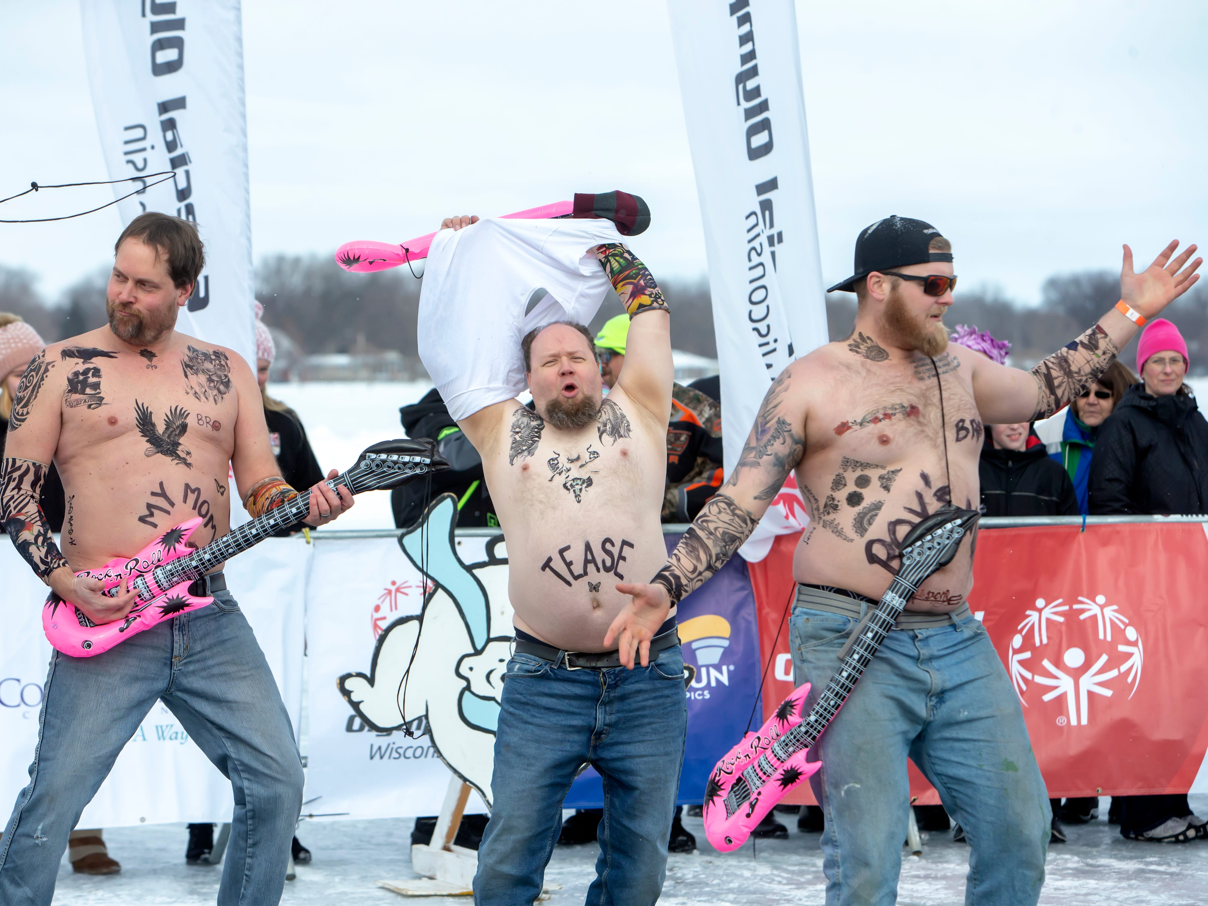 Pete's Garbage rock stars prepare to take the plunge during the Special Olympics Wisconsin Polar Plunge in Oshkosh, Wis., on Saturday, February 16, 2019, at Miller's Bay in Menominee Park.