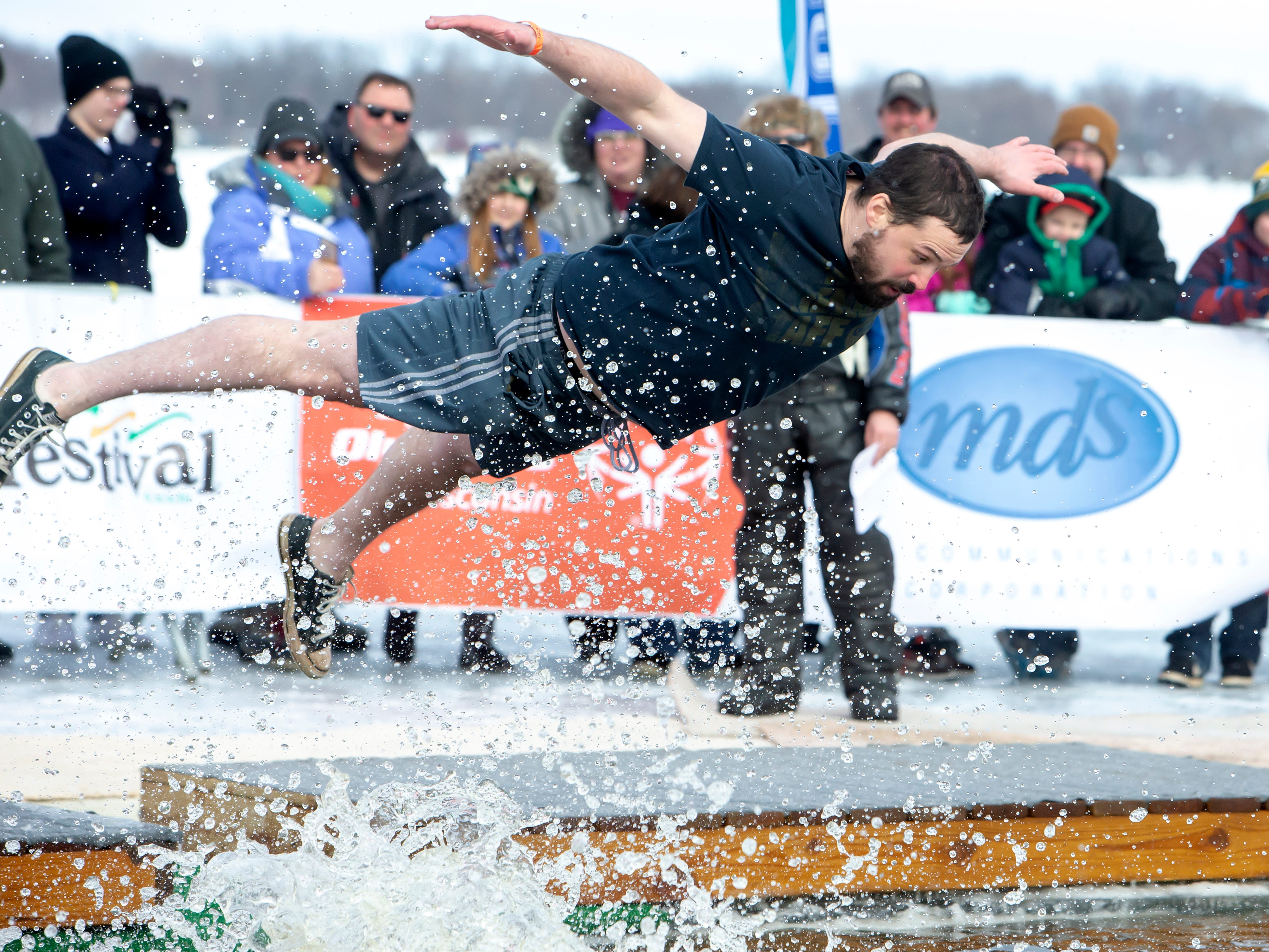 A plunging participant dives into the freezing water during the Special Olympics Wisconsin Polar Plunge in Oshkosh, Wis., on Saturday, February 16, 2019, at Miller's Bay in Menominee Park.