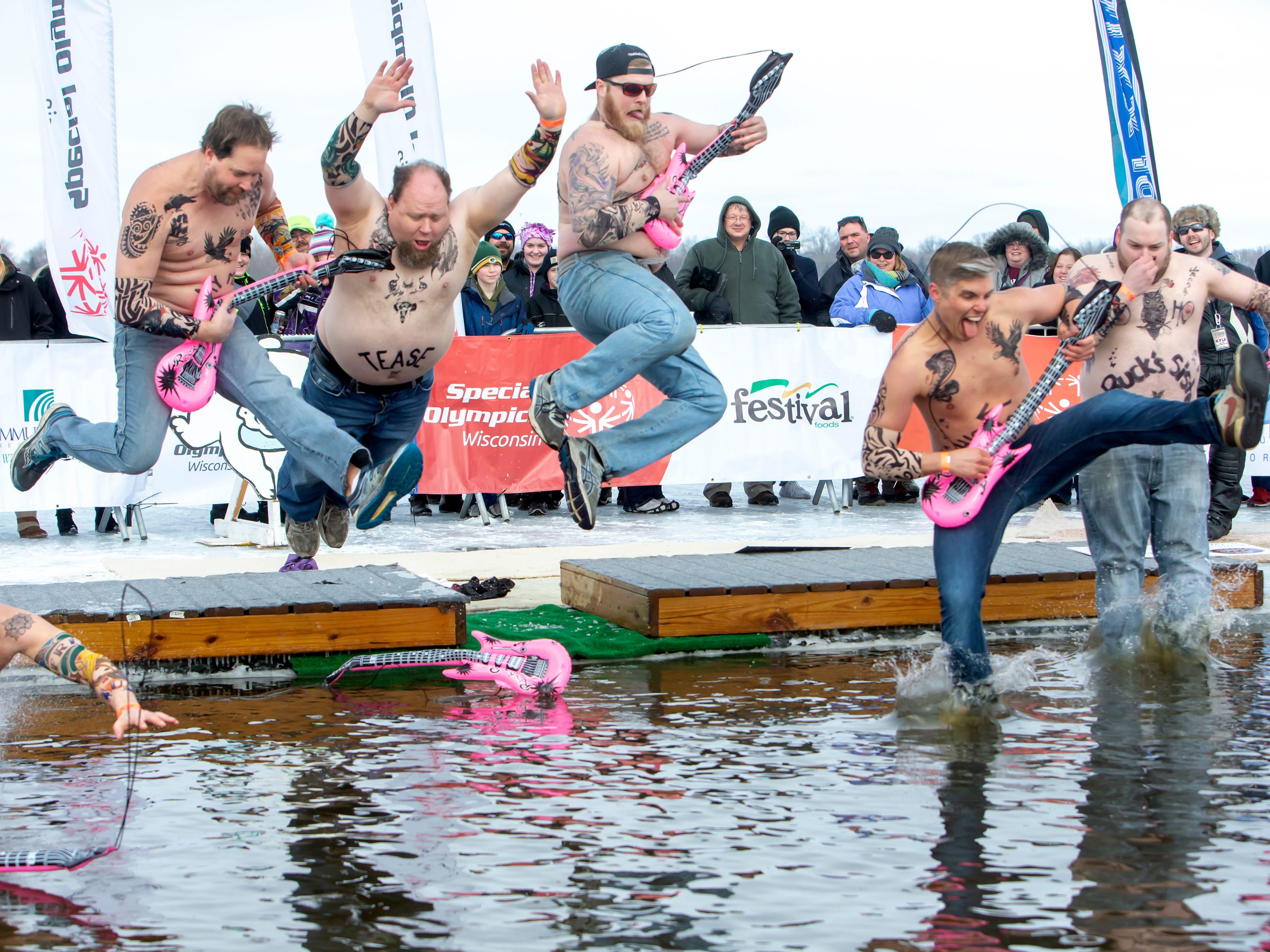 Pete's Garage gang dressed as rock stars take the plunge during the Special Olympics Wisconsin Polar Plunge in Oshkosh, Wis., on Saturday, February 16, 2019, at Miller's Bay in Menominee Park.