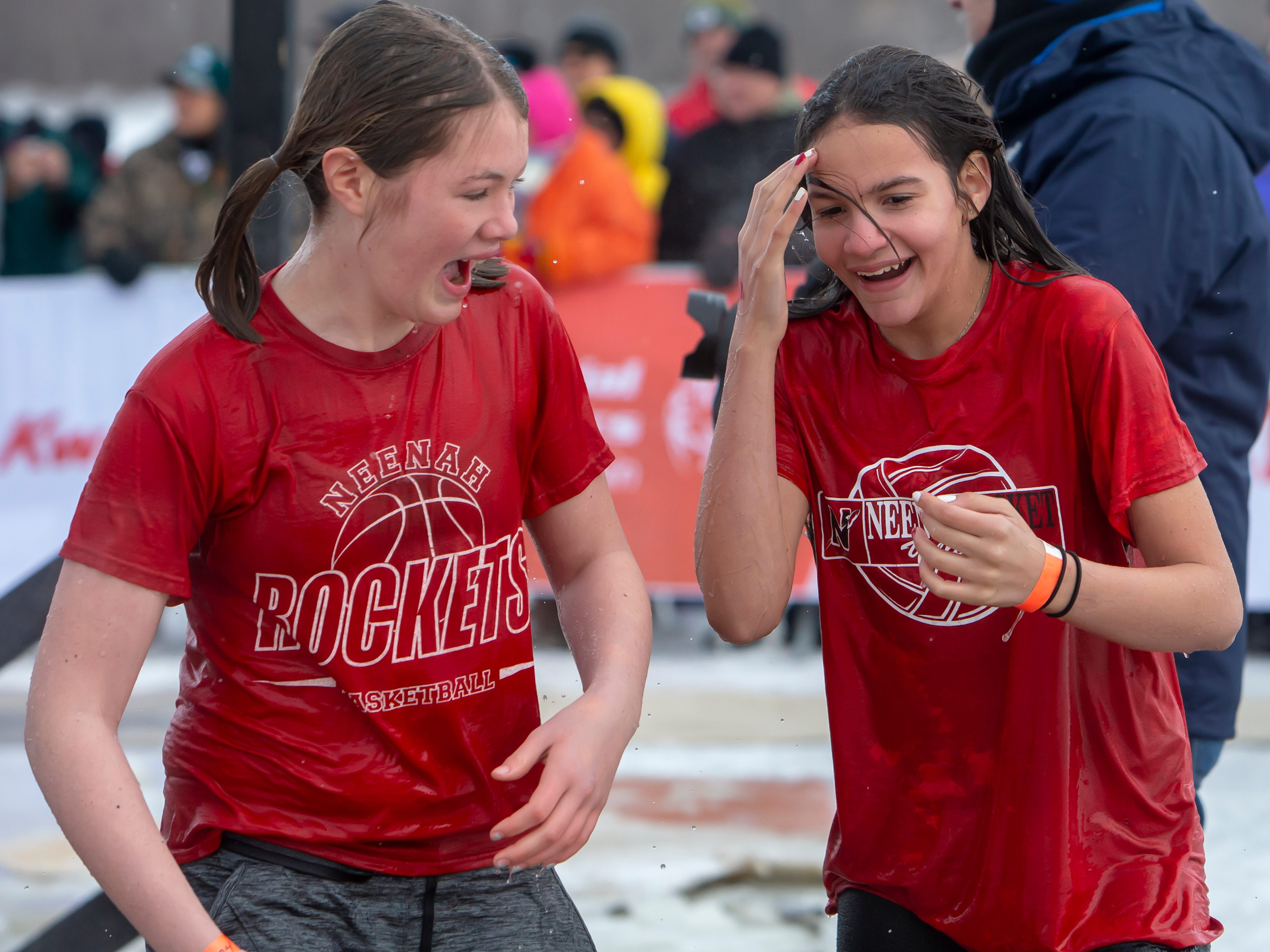 Neenah students react after their jump in the freezing water during the Special Olympics Wisconsin Polar Plunge in Oshkosh, Wis., on Saturday, February 16, 2019, at Miller's Bay in Menominee Park.