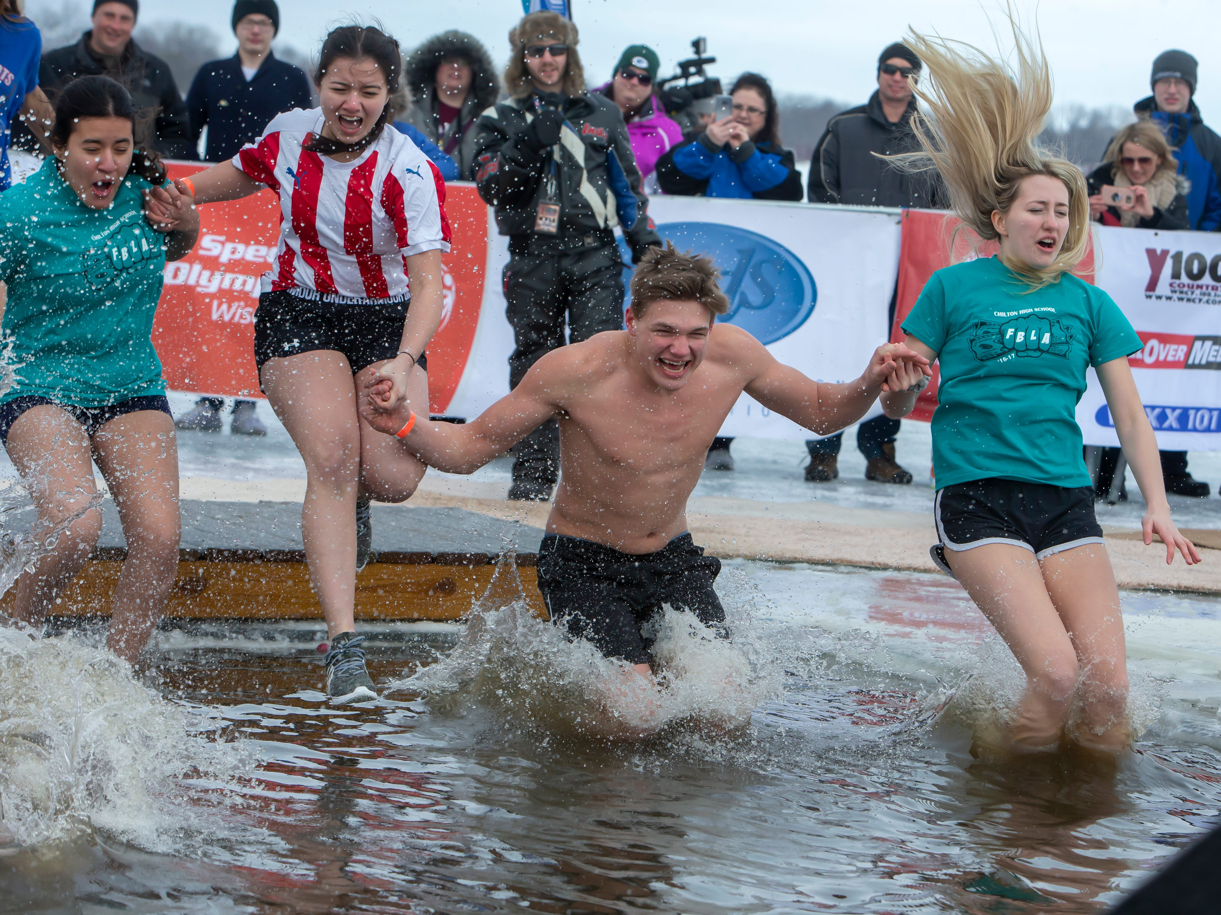 Chilton High School student take the plunge during the Special Olympics Wisconsin Polar Plunge in Oshkosh, Wis., on Saturday, February 16, 2019, at Miller's Bay in Menominee Park.