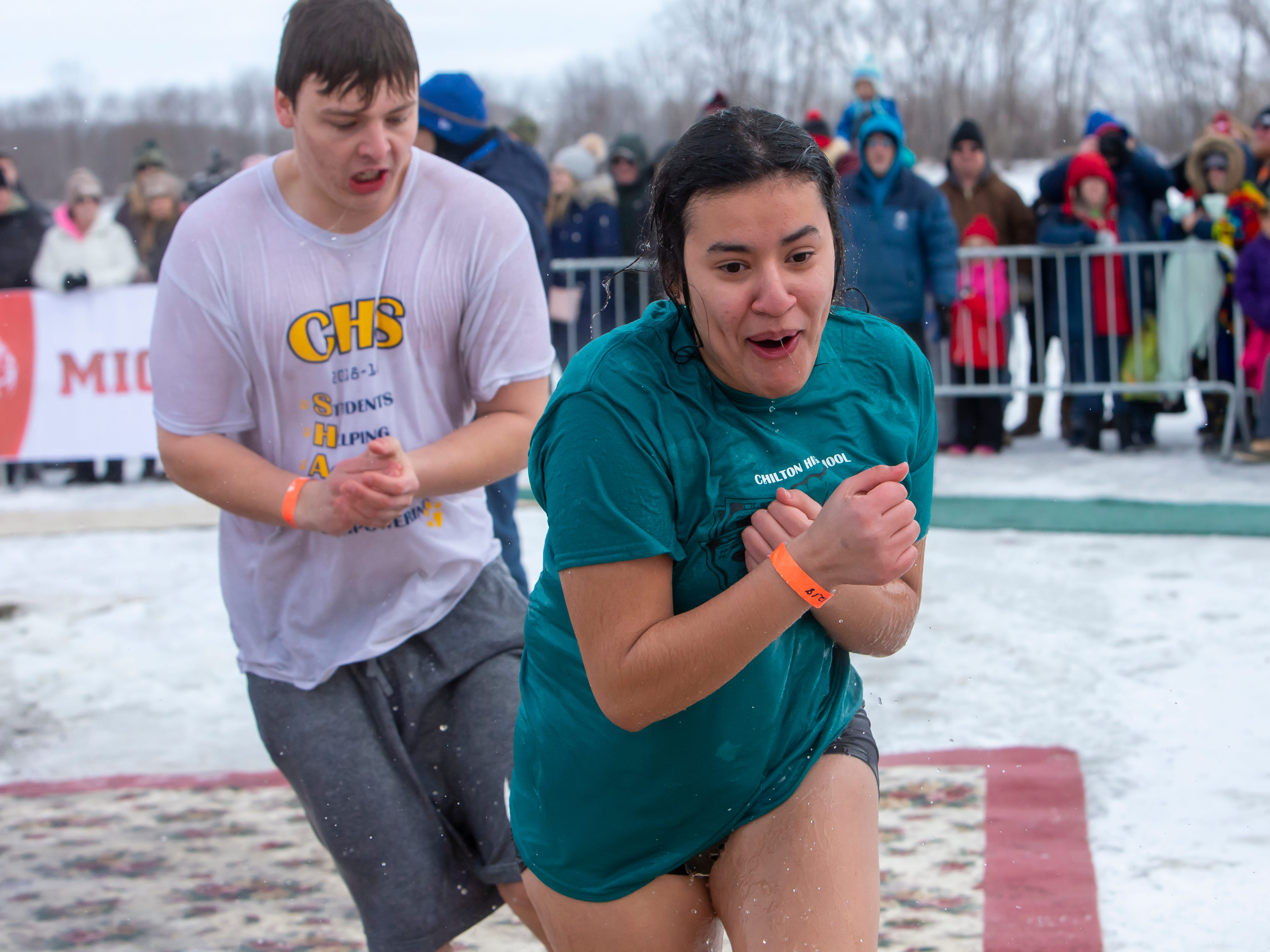 Chilton High School students react after coming out of the water during the Special Olympics Wisconsin Polar Plunge in Oshkosh, Wis., on Saturday, February 16, 2019, at Miller's Bay in Menominee Park.