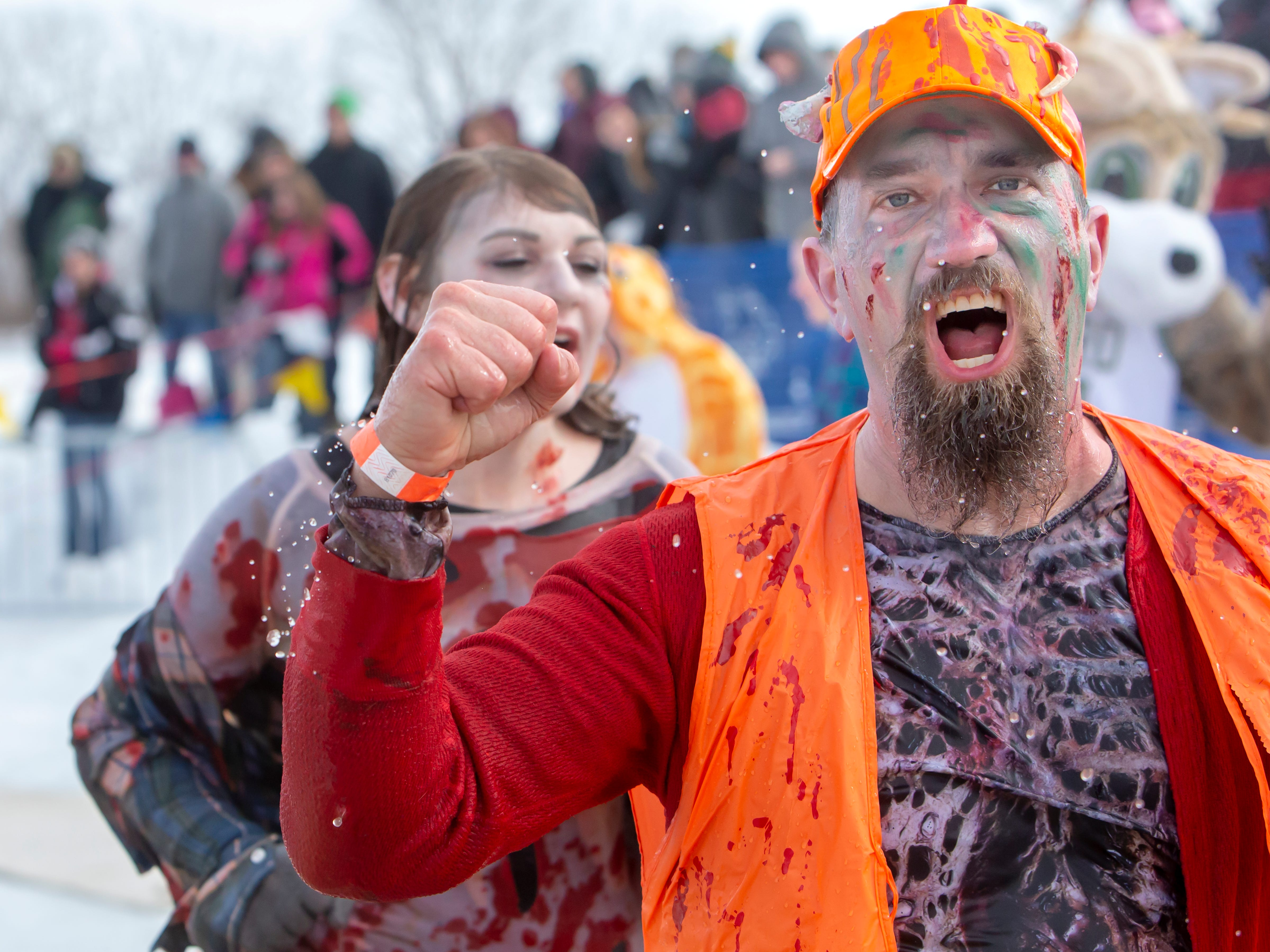 People react after their plunge into the freezing water during the Special Olympics Wisconsin Polar Plunge in Oshkosh, Wis., on Saturday, February 16, 2019, at Miller's Bay in Menominee Park.