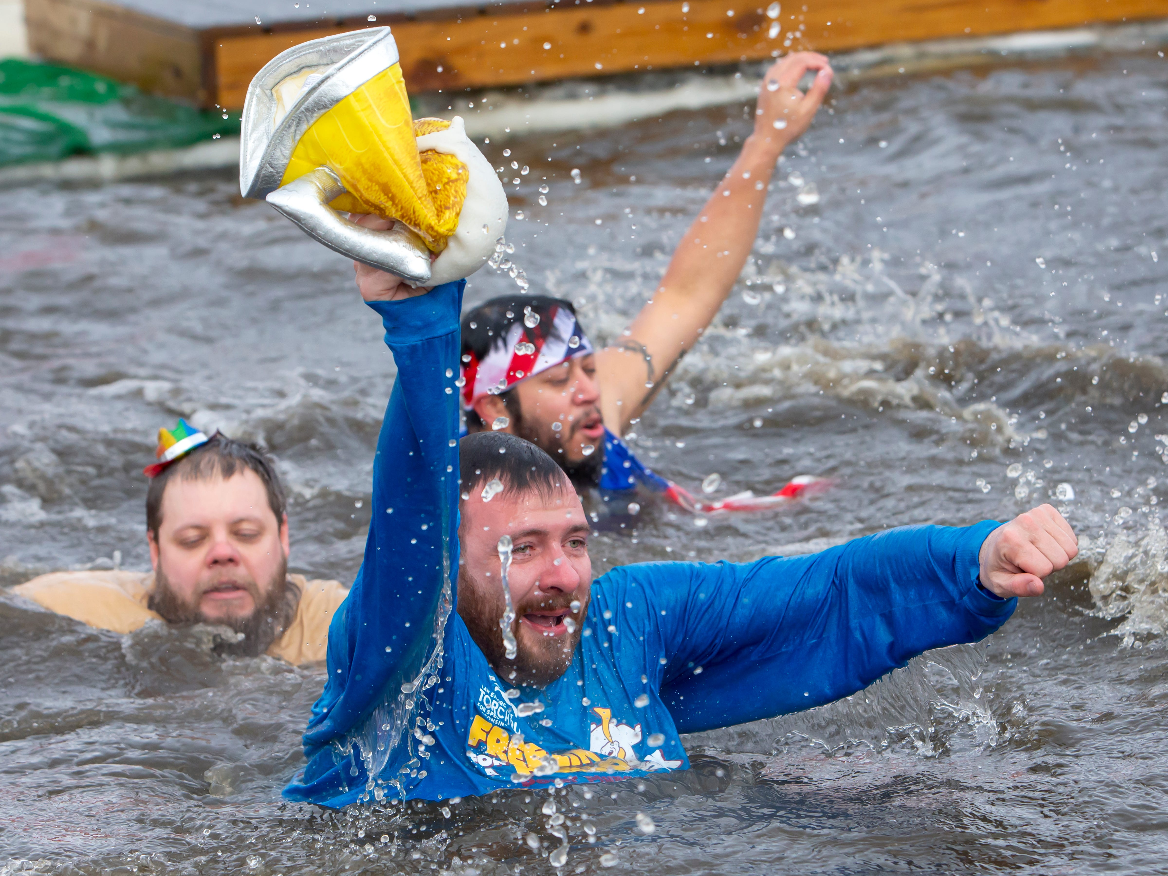 People react while in the freezing water during the Special Olympics Wisconsin Polar Plunge in Oshkosh, Wis., on Saturday, February 16, 2019, at Miller's Bay in Menominee Park.