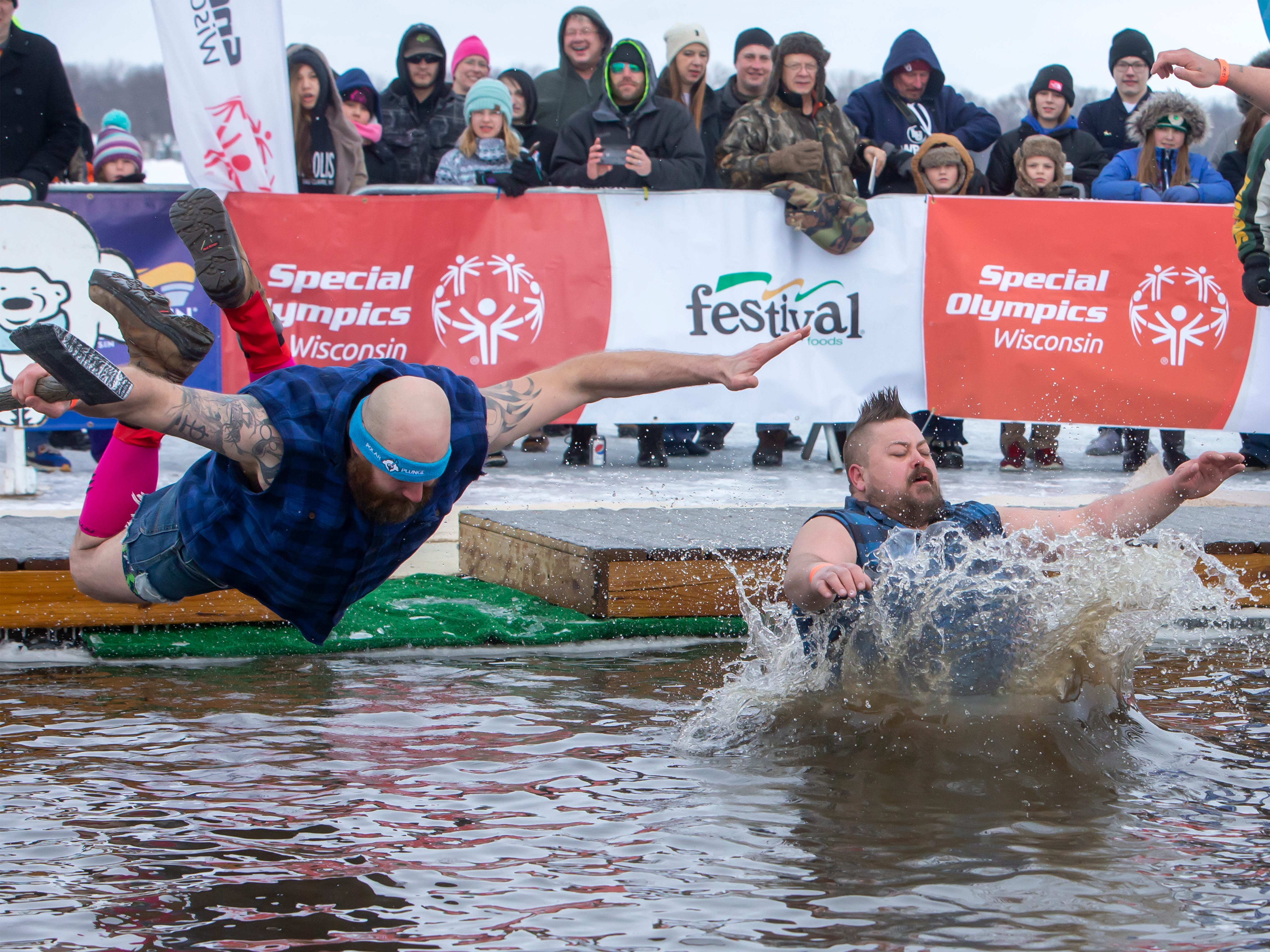 Jered Blatz, left, and Kory Jacobs attend the event early to be one of the first to plunge into the cold water during the Special Olympics Wisconsin Polar Plunge in Oshkosh, Wis, on Saturday, February 16, 2019, at Miller's Bay in Menominee Park.