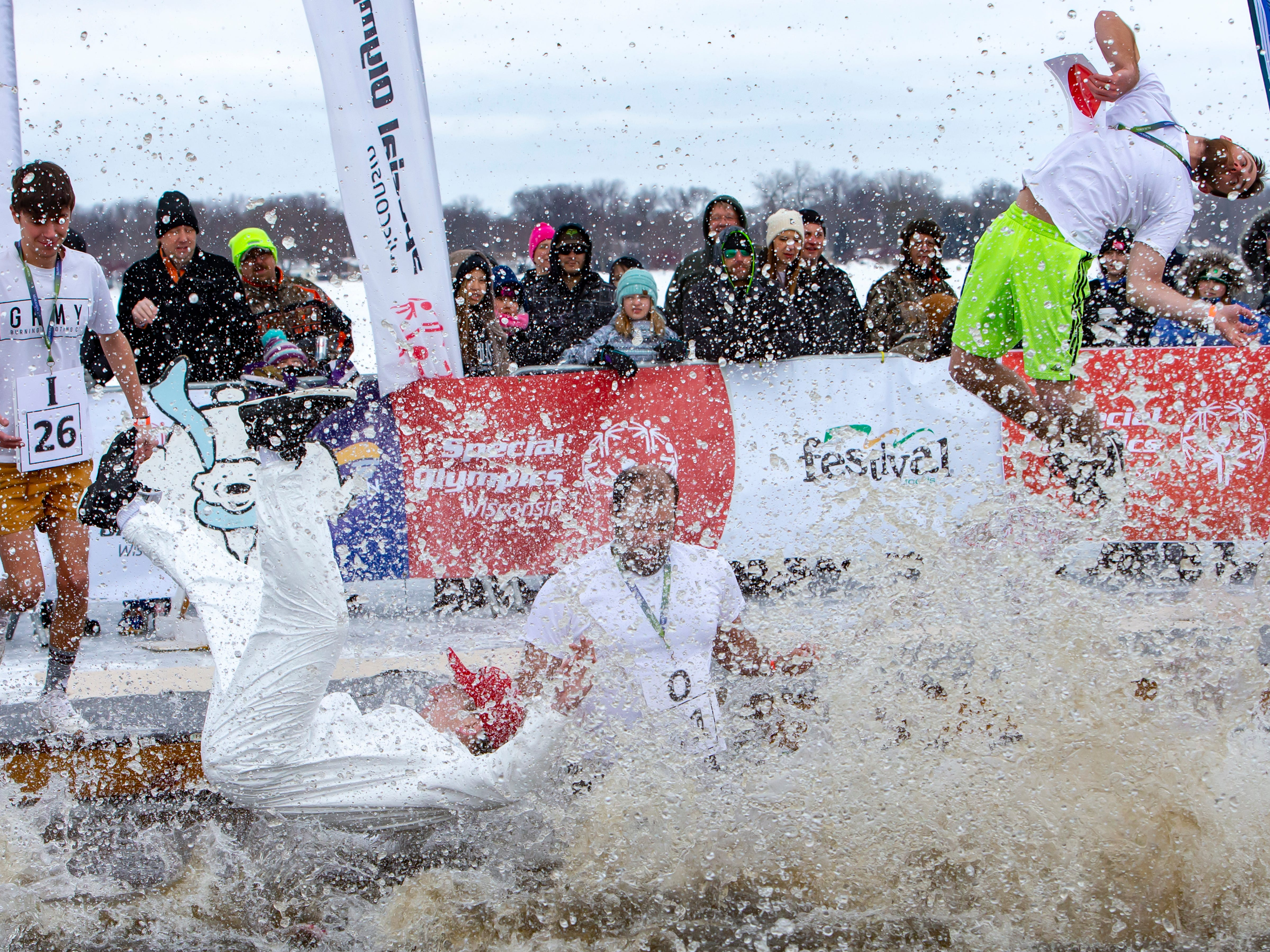 McMahon employees take the plunge during the Special Olympics Wisconsin Polar Plunge in Oshkosh, Wis., on Saturday, February 16, 2019, at Miller's Bay in Menominee Park.