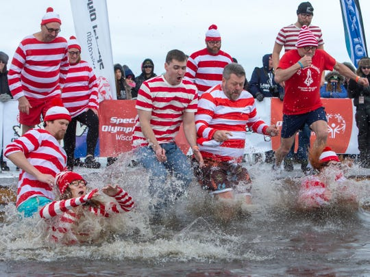 Employees of Neenah Inc. take the plunge during the Special Olympics Wisconsin Polar Plunge in Oshkosh, Wis., on Saturday, February 16, 2019, at Miller's Bay in Menominee Park.