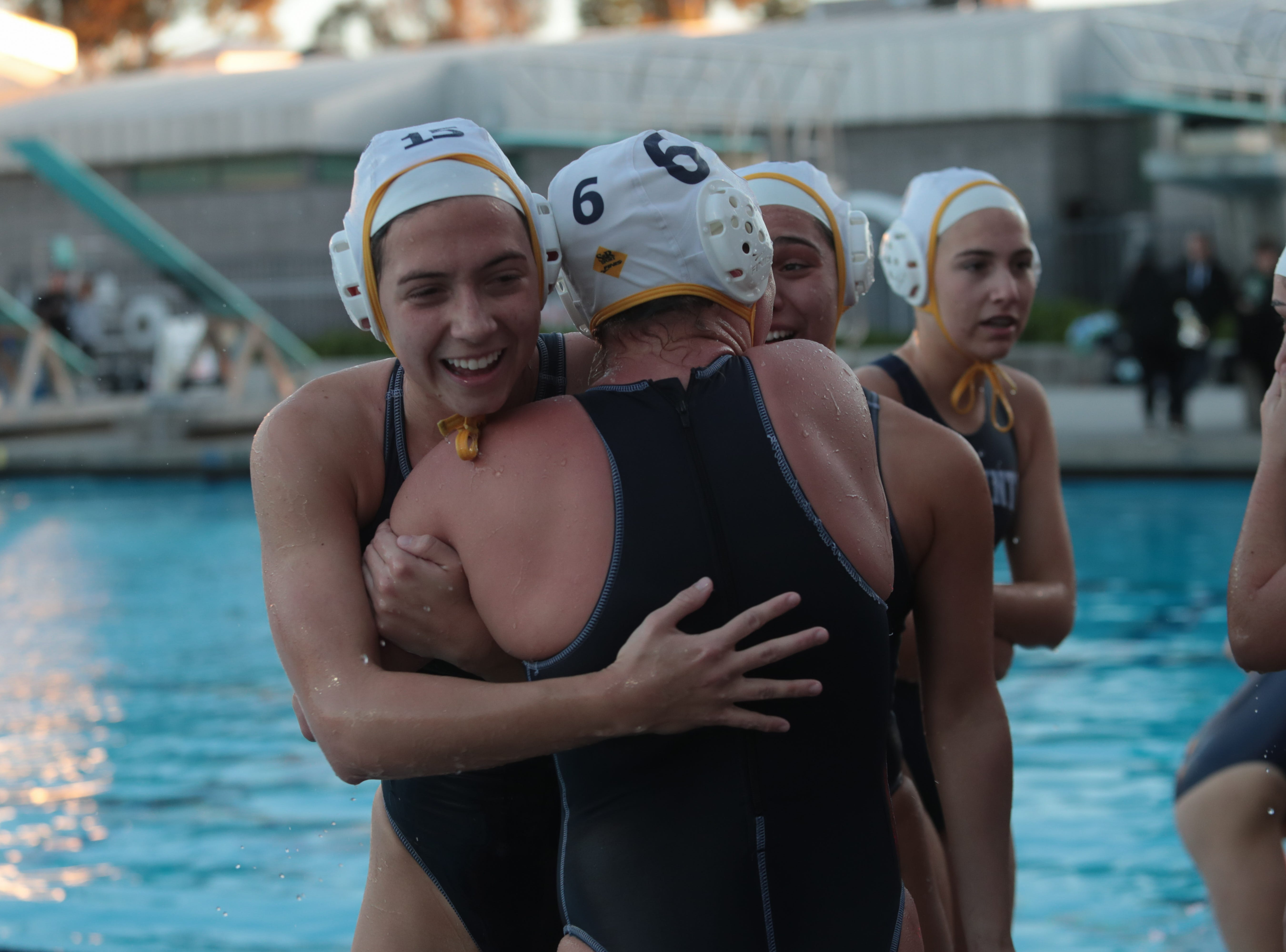 Virginia Lowell hugs teammate Savannah Hampton after winning the CIF Southern Section Division 4 championships, Irvine, Calif., Saturday, February 16, 2019.