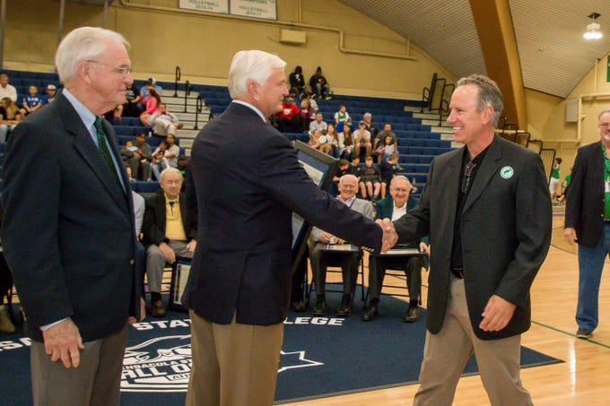 Greg Litton, right, is honored during Pensacola State College's inaugural Athletics Hall of Fame induction ceremony on Saturday, February 16, 2019, in the Hartsell Arena on the main campus. A Woodham High School graduate, Litton played on the PSC baseball team during the 1983-84 season and played for the San Francisco Giants, Seattle Mariners, and Boston Red Sox before retiring in 1994.