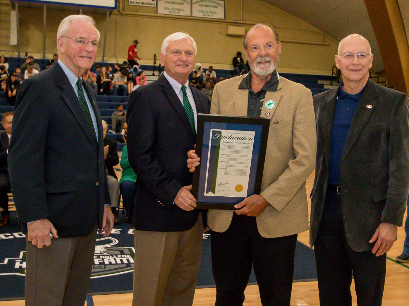 Charles Fairchild, second from right, is honored during Pensacola State College's inaugural Athletics Hall of Fame induction ceremony on Saturday, February 16, 2019, in the Hartsell Arena on the main campus. He was a member of the college's first state championship baksetball team during the 1962-63 season and helped bring a professional basketball team to Pensacola, the Continental Basketball Association's Pensacola Tornados, in the mid-1980's.