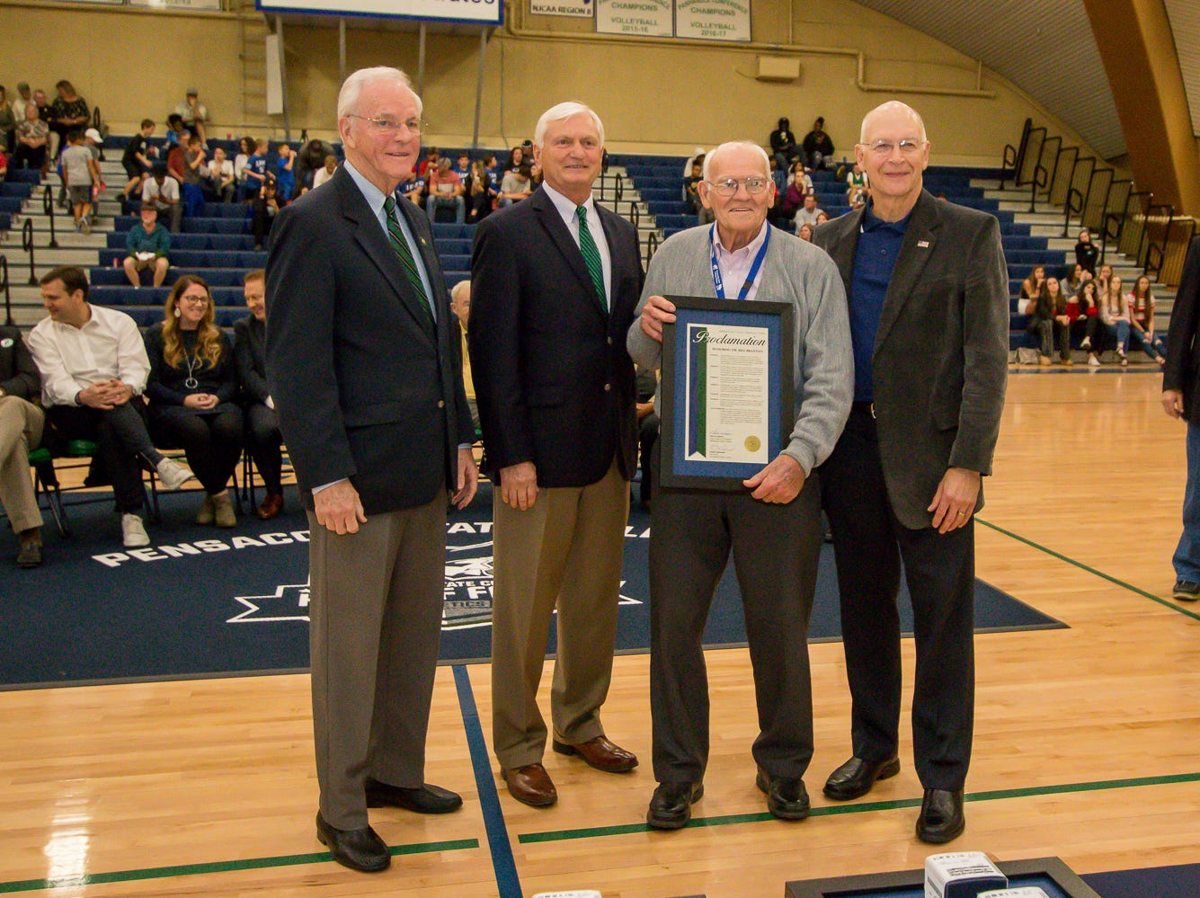 Dr. Bill Brantley, second from right, is honored during Pensacola State College's inaugural Athletics Hall of Fame induction ceremony on Saturday, February 16, 2019, in the Hartsell Arena on the main campus. A former basketball player, Brantley taught at the college for over 30 years, and continues to donate to the PSC Foundation and the athletics department.