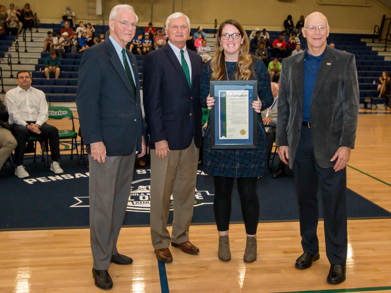 Dana Gilmore, second from right, is honored during Pensacola State College's inaugural Athletics Hall of Fame induction ceremony on Saturday, February 16, 2019, in the Hartsell Arena on the main campus. She is the college's most-decorated female athlete, including being named an All-Conference, All-State, and All-American athlete multiple times in both softball and volleyball. She currently is an assistant softball coach at Tate High School.