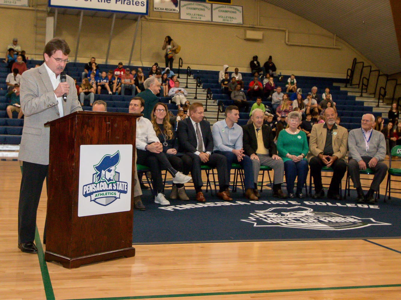 Dan Shugart, sports director for WEAR-TV3, announces the inductees during Pensacola State College's inaugural Athletics Hall of Fame induction ceremony on Saturday, February 16, 2019, in the Hartsell Arena on the main campus.