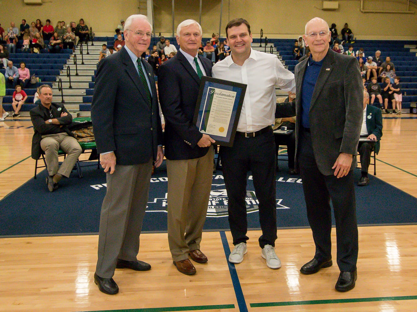 Dennis Lindsey, second from right, is honored during Pensacola State College's inaugural Athletics Hall of Fame induction ceremony on Saturday, February 16, 2019, in the Hartsell Arena on the main campus. He coached both men's and women's basketball at PSC in the mid 1990's, before joining the Houston Rockets in 1996. From 2007-12, he was the assistant general manager for the San Antonio Spurs. He has been the general manager for the Utah Jazz since 2012.