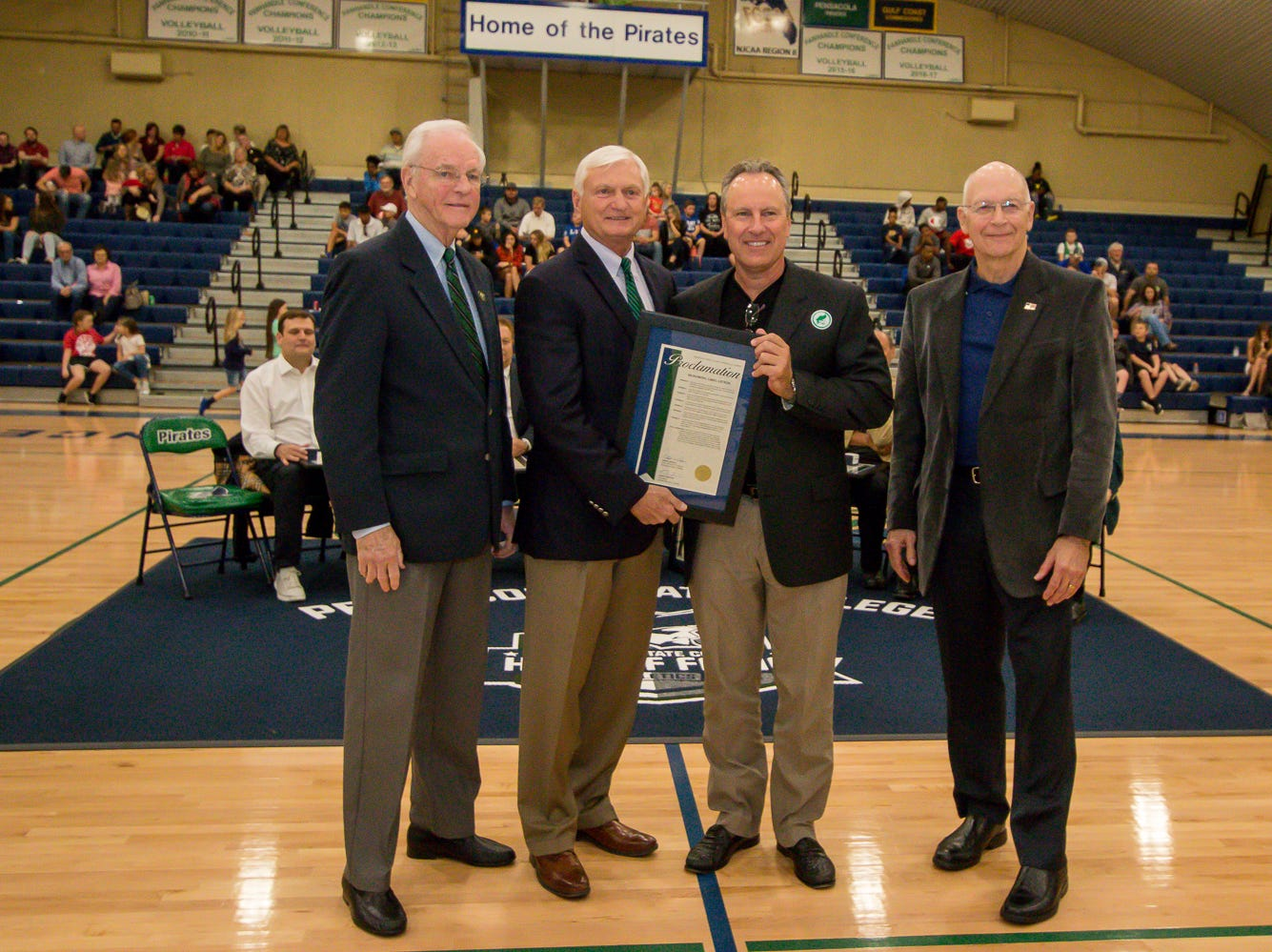 Greg Litton, second from right, is honored during Pensacola State College's inaugural Athletics Hall of Fame induction ceremony on Saturday, February 16, 2019, in the Hartsell Arena on the main campus. A Woodham High School graduate, Litton played on the PSC baseball team during the 1983-84 season and played for the San Francisco Giants, Seattle Mariners, and Boston Red Sox before retiring in 1994.