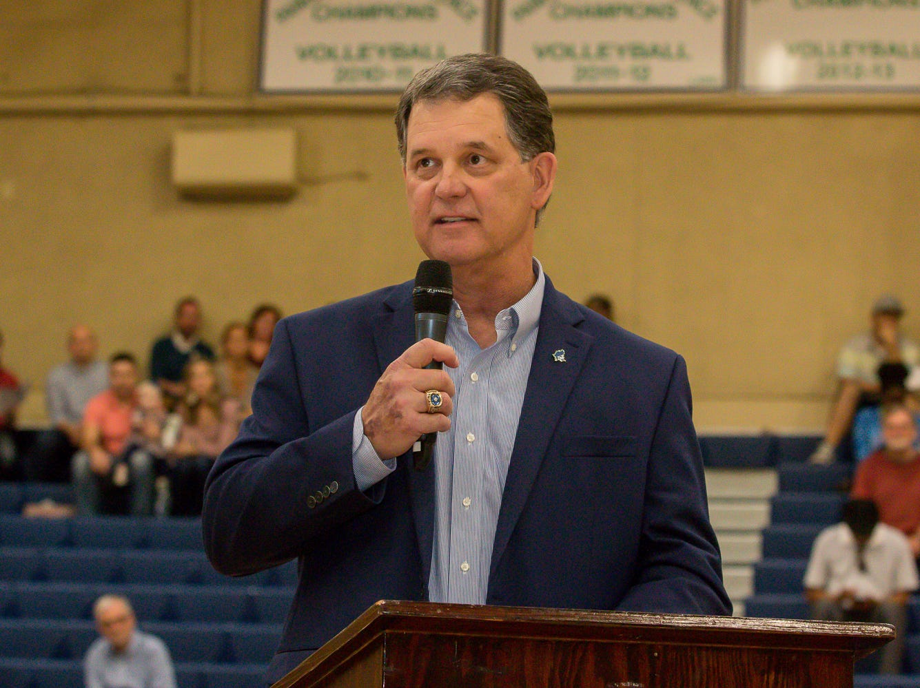 Bill Hamilton, director of athletics at Pensacola State College, speaks during the college's inaugural Athletics Hall of Fame induction ceremony on Saturday, February 16, 2019, in the Hartsell Arena on the main campus.